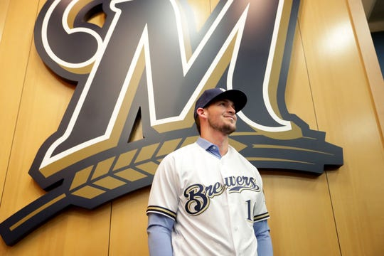 Yasmani Grandal, the Brewers' new catcher, waits to be interviewed at a news conference introducing him.