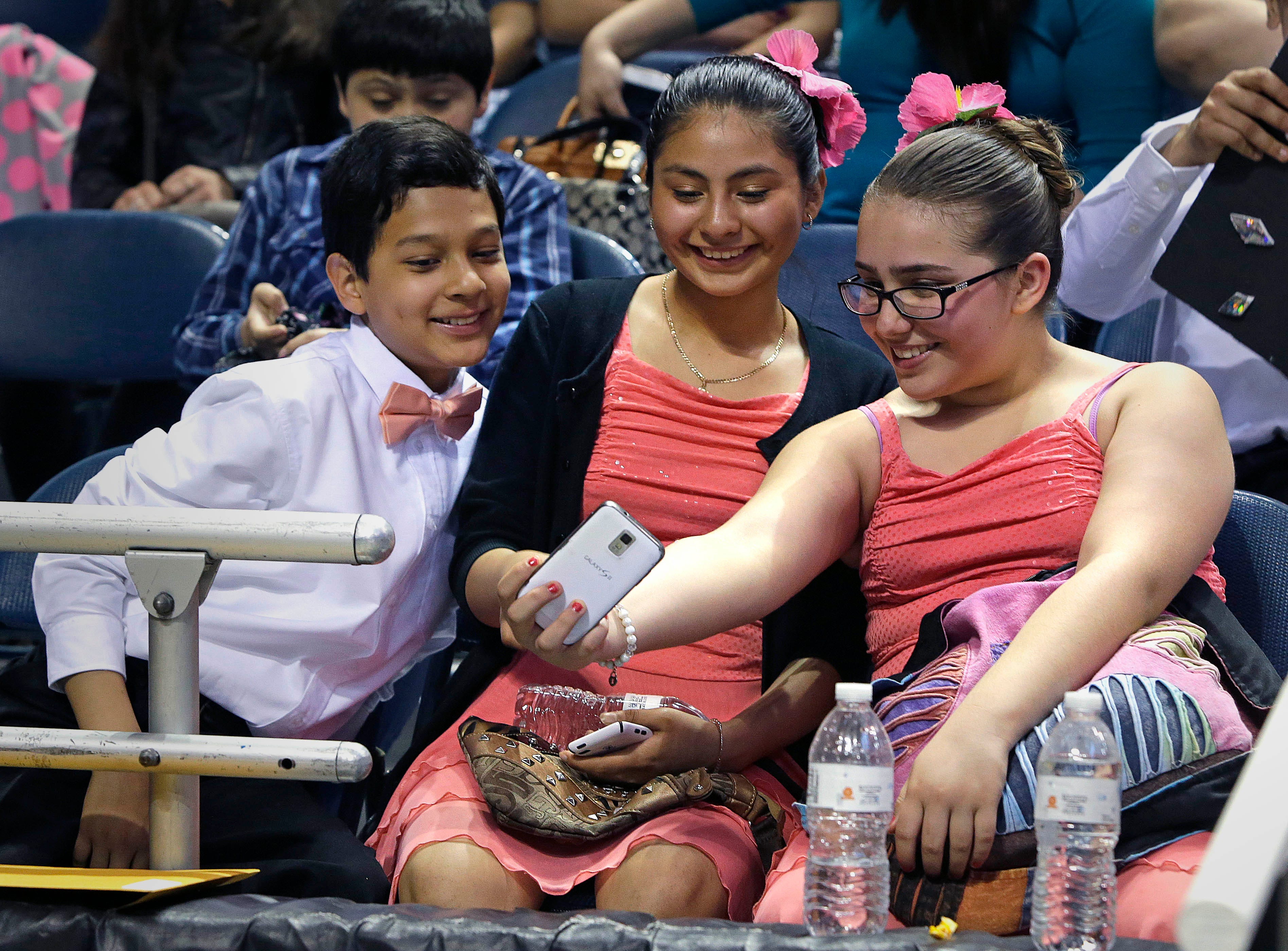 2015: Students from Vieau Elementary School watch a video of their performance during the annual Mad Hot Ballroom and Tap competition at the Bradley Center.