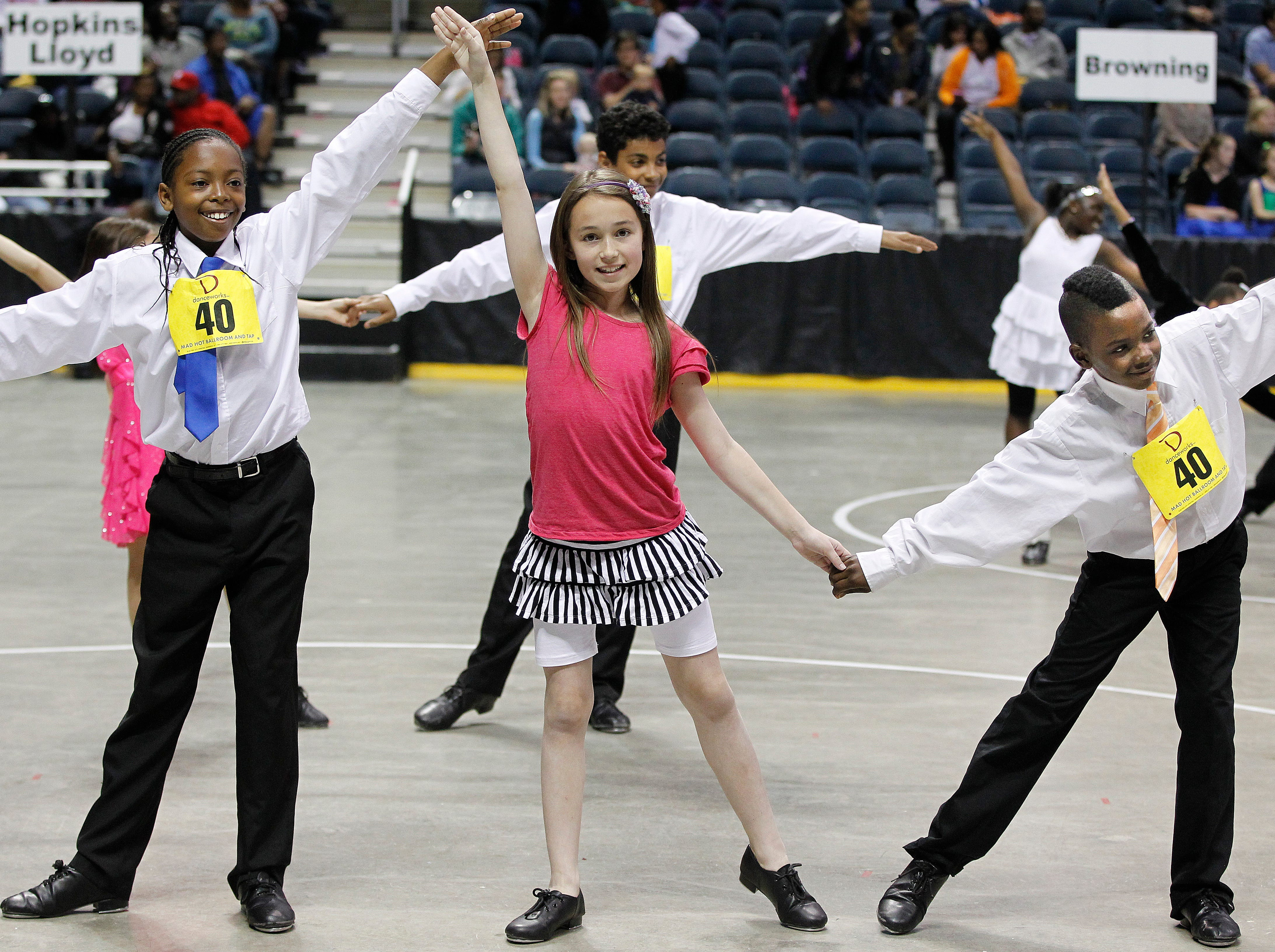2014: Students from Roosevelt Elementary School strike a pose before dancing during the annual Mad Hot Ballroom and Tap competition at the BMO Harris Bradley Center.
