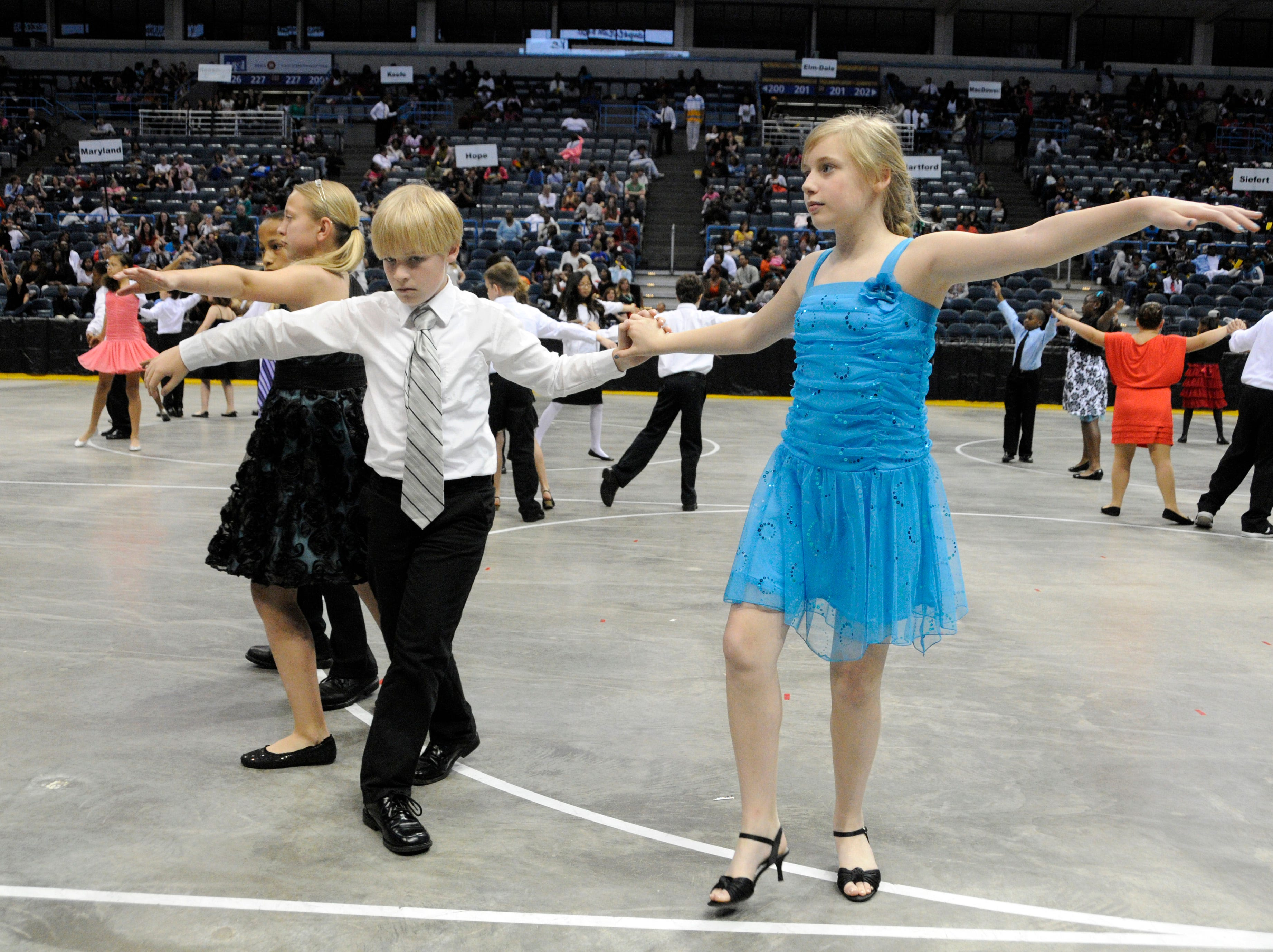 2012: Brian Keon and Molly McCready of Roosevelt Elementary School in Wauwatosa dance the tango during the Danceworks Mad Hot Ballroom and Tap competition at the Bradley Center.