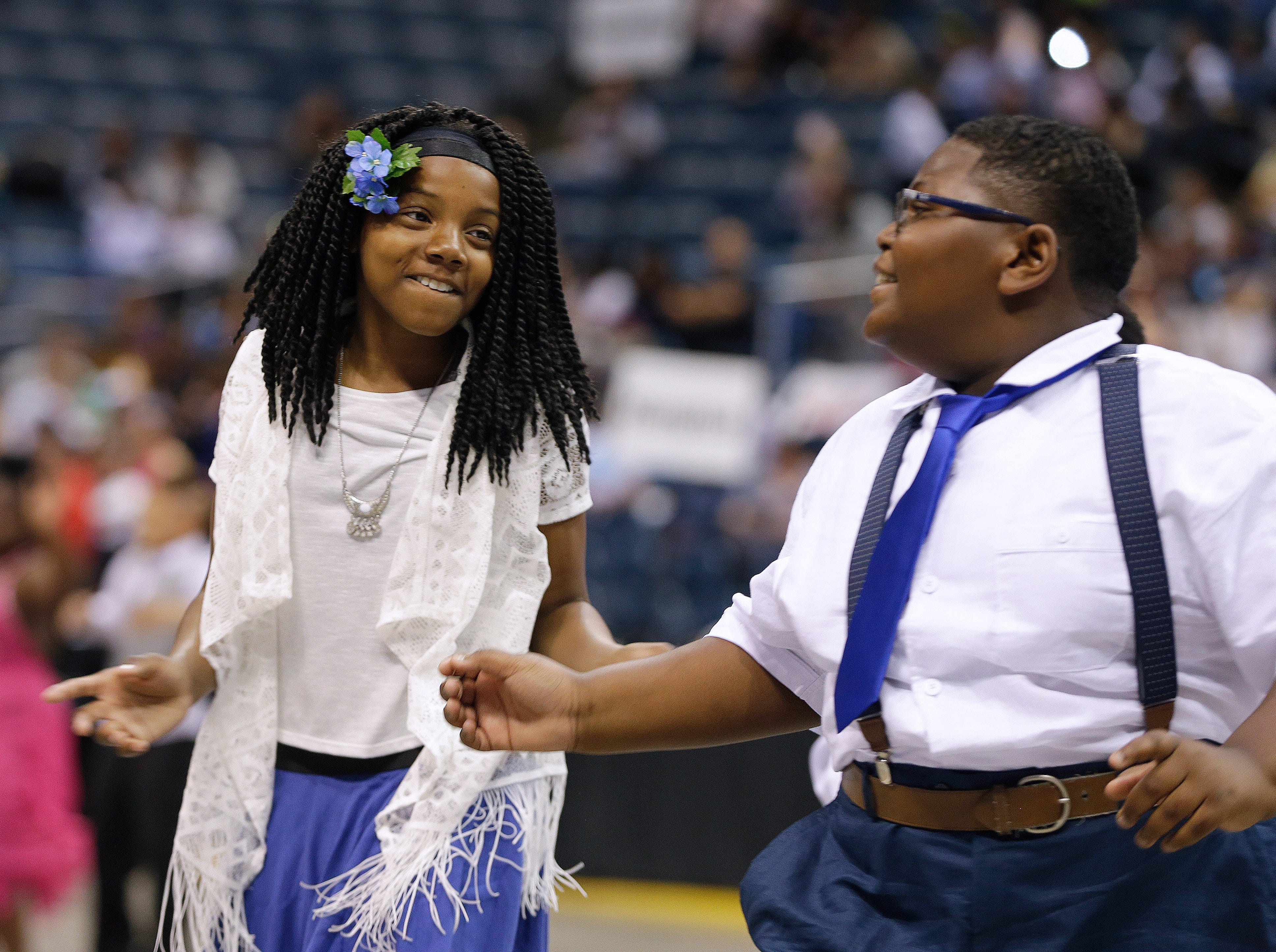 2016: Jalony Brown, and Tamaiah Laster, 10, both from Craig Montessori school, dance in the annual Mad Hot Ballroom and Tap competition at the BMO Harris Bradley Center.
