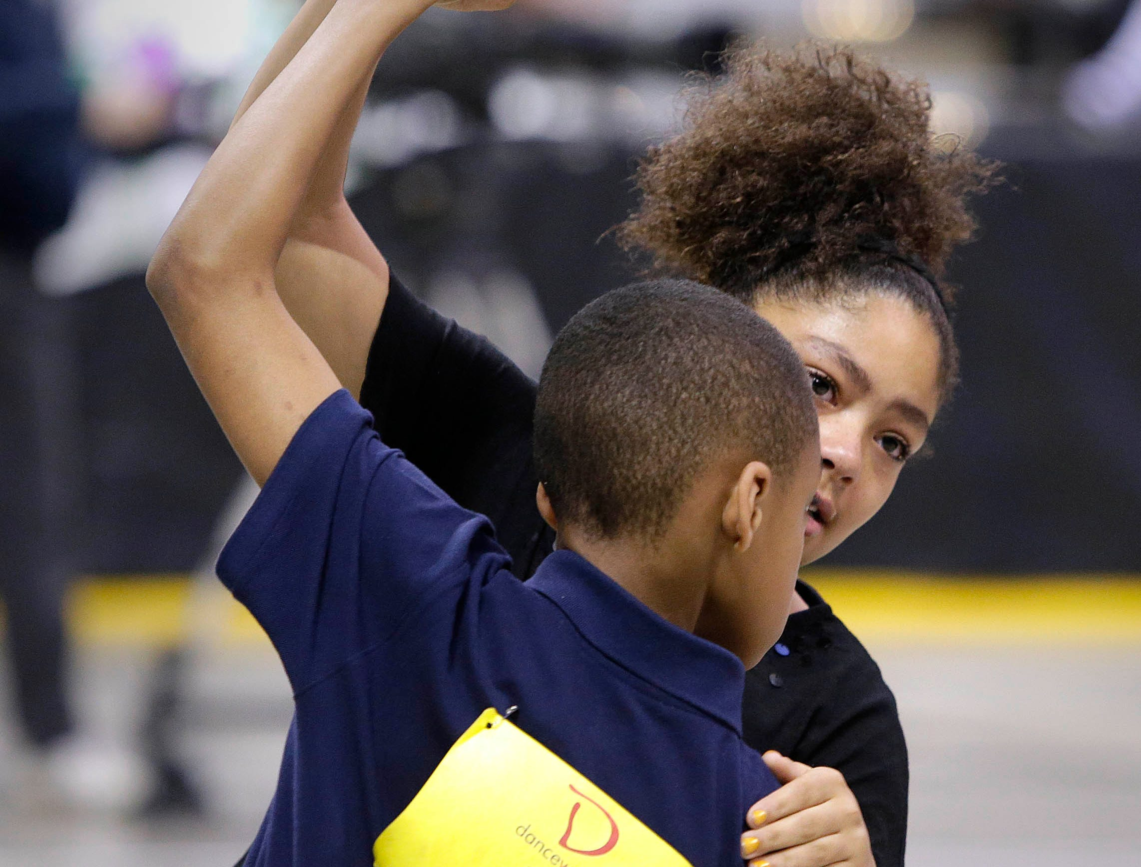 2015: Tiana Rowley  and Christopher Edwards, from Brown Street Academy,  perform in the annual Mad Hot Ballroom and Tap competition at the Bradley Center.