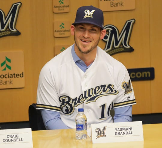Yasmani Grandal answers questions at a news conference at Miller Park Tuesday morning.