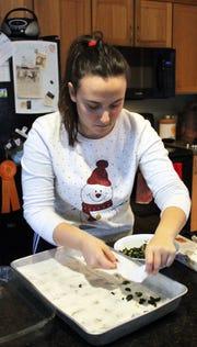 Bora Ajdini of Albania assembles her family's byrek recipe.