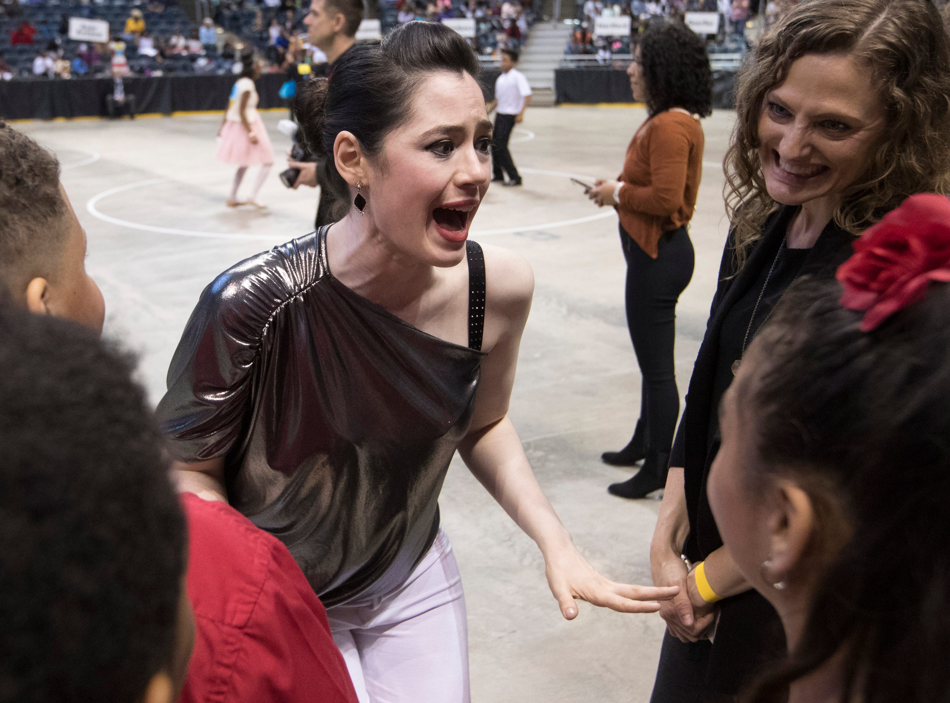 2018: Danceworks teacher Betsy Guerrero shares words of encouragement before student take to the floor during the 12th annual  Danceworks Mad Hot Ballroom and Tap Competition at the BMO Harris Bradley Center.