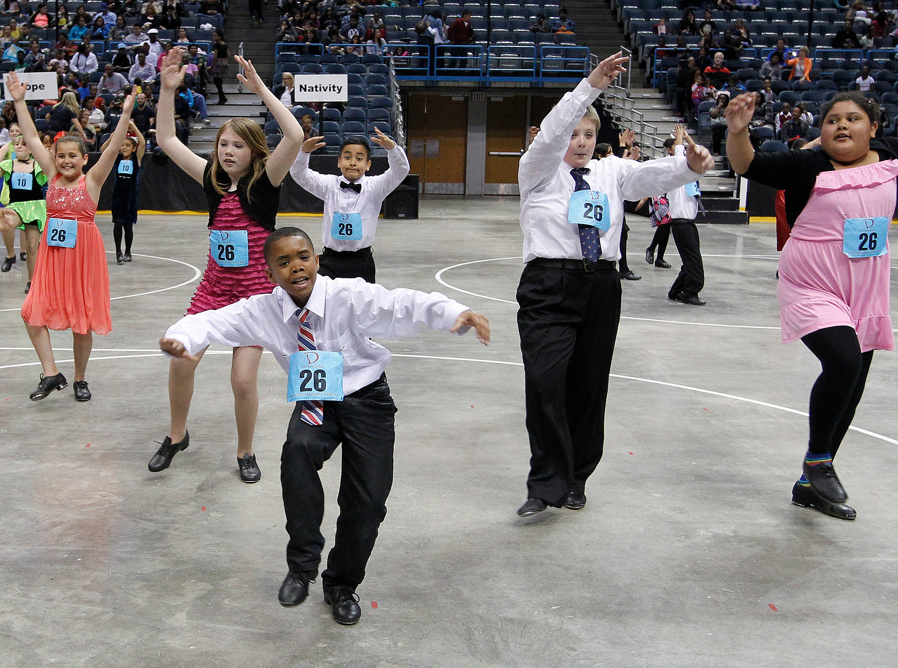 2014: Students from Lowell Elementary School dance during the annual Mad Hot Ballroom and Tap competition at the BMO Harris Bradley Center.