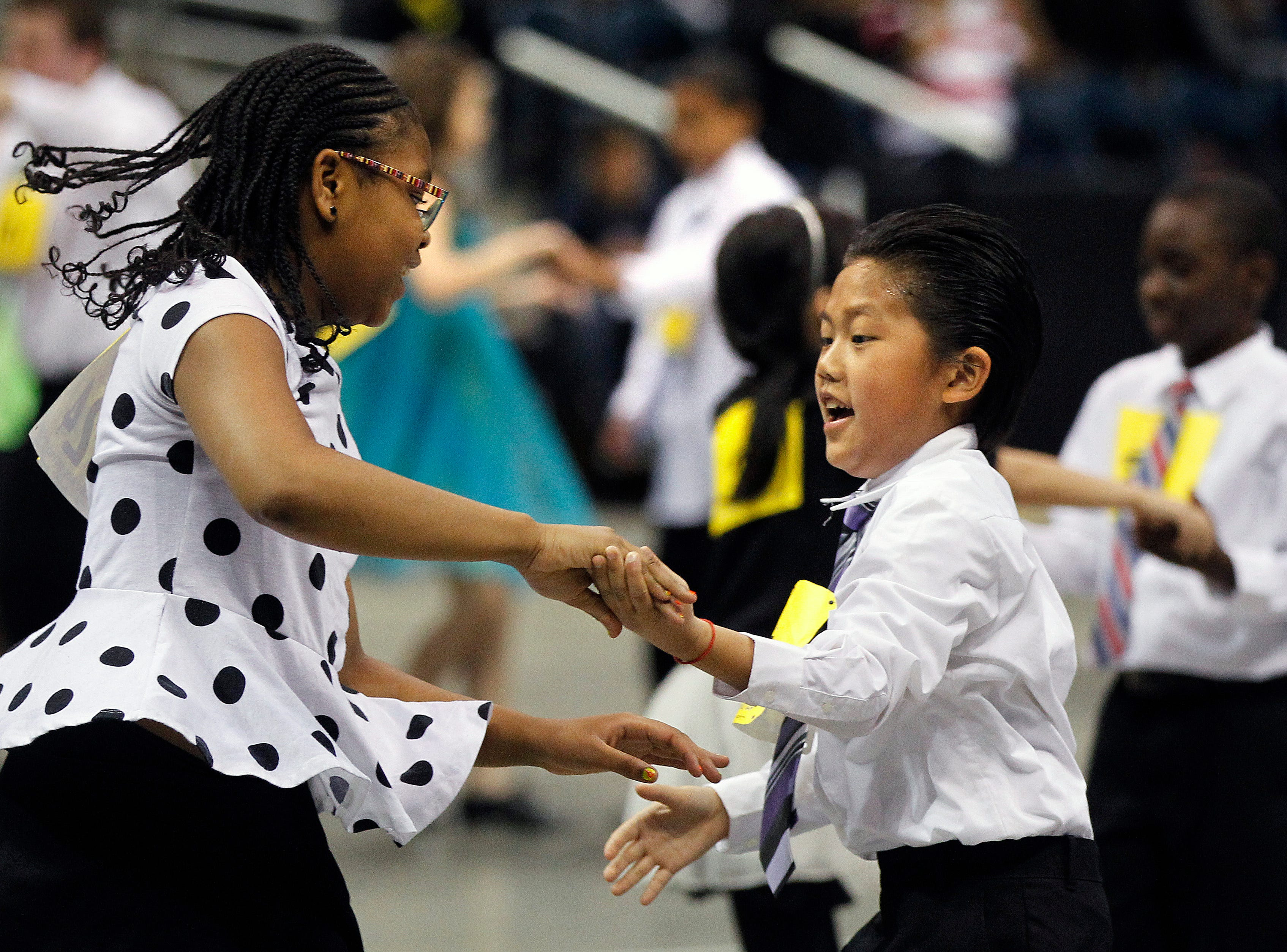 2014: Students from Kluge Elementary School dance during the annual Mad Hot Ballroom and Tap competition at the BMO Harris Bradley Center.