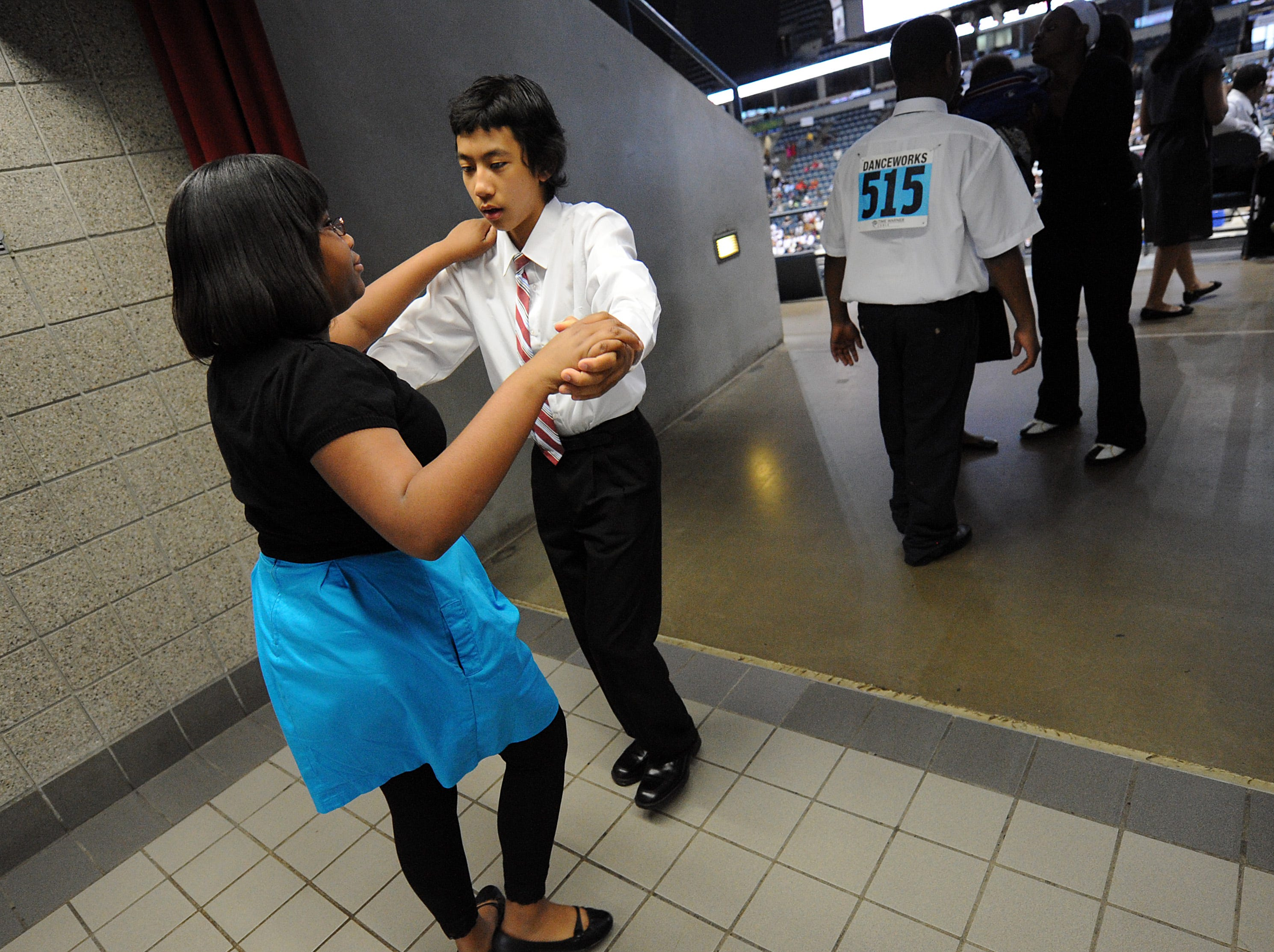 2010: Mark Mendoza (center) practices the tango with his partner Tranace Leonard shortly before the annual Mad Hot Ballroom and Tap Competition at the Bradley Center. Both Mendoza and Leonard are sixth-graders at Cass Street School.
