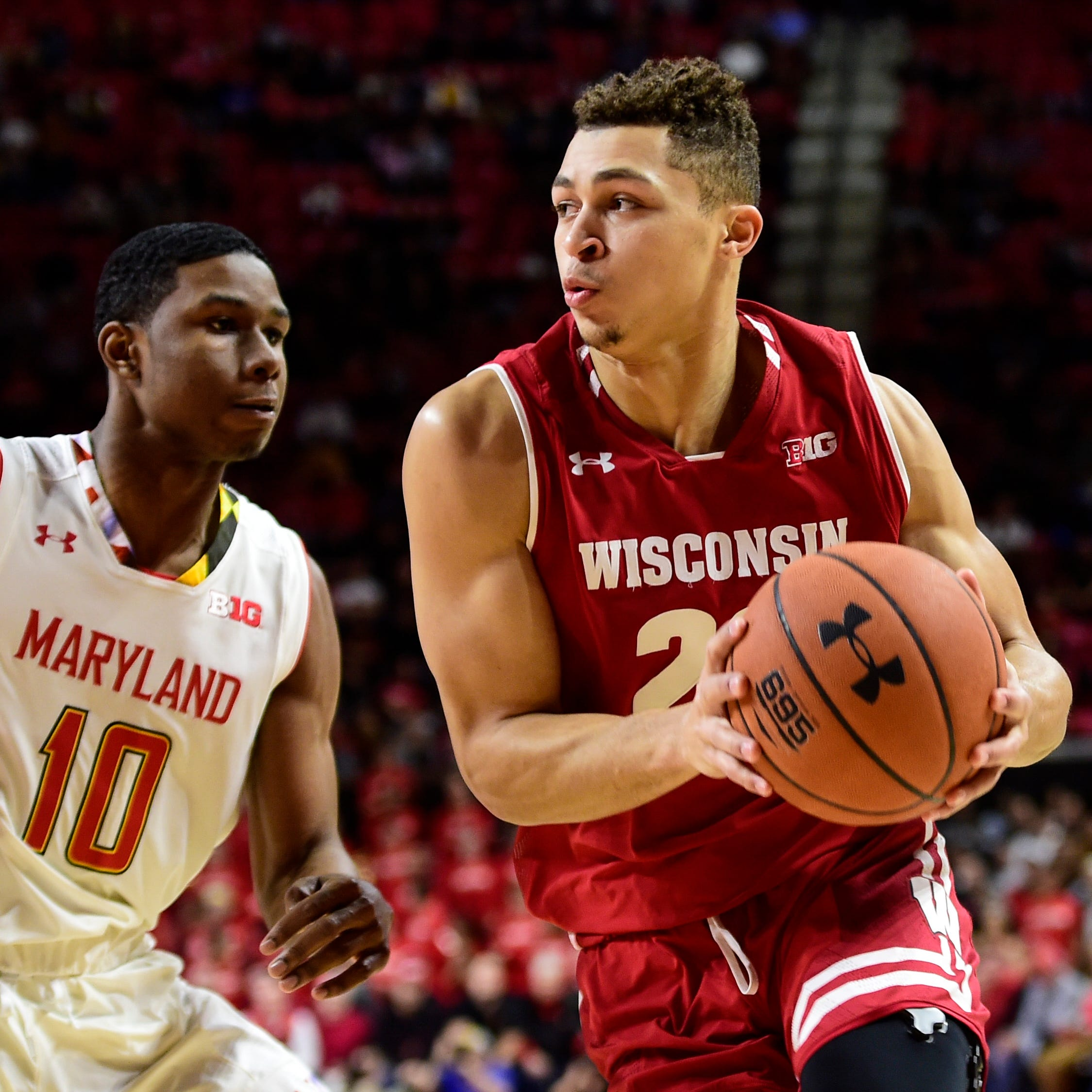 Badgers guard Kobe King makes a move to the...