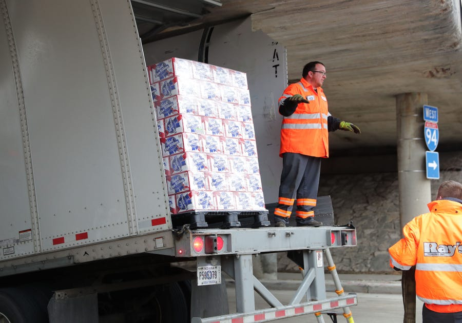 Pabst Blue Ribbon beer is removed from the trailer.