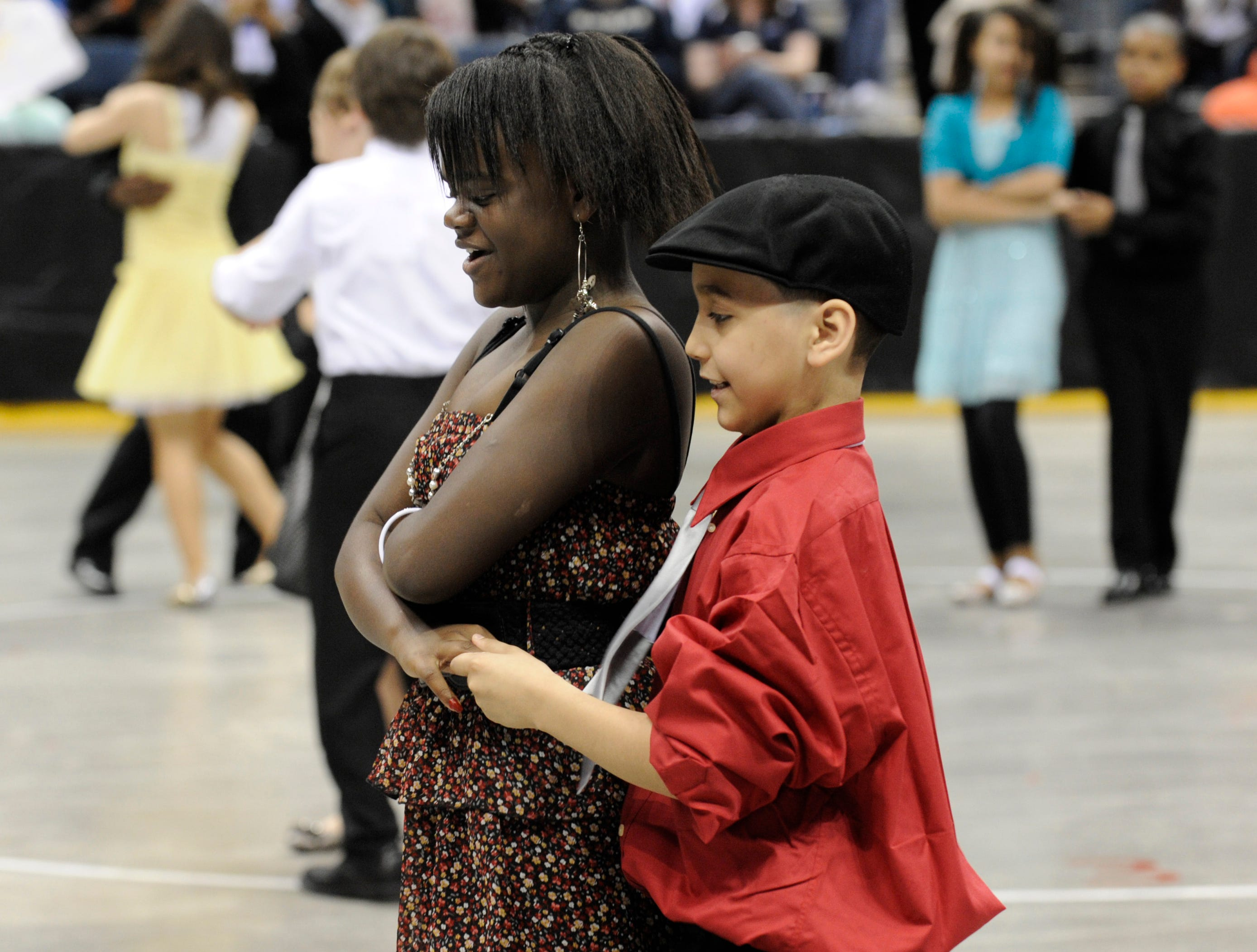 2012: Carlos Alba and Destiny Wilson, both 5th graders at Pierce Elementary, dance the jitterbug during the Danceworks Mad Hot Ballroom and Tap competition at the Bradley Center.