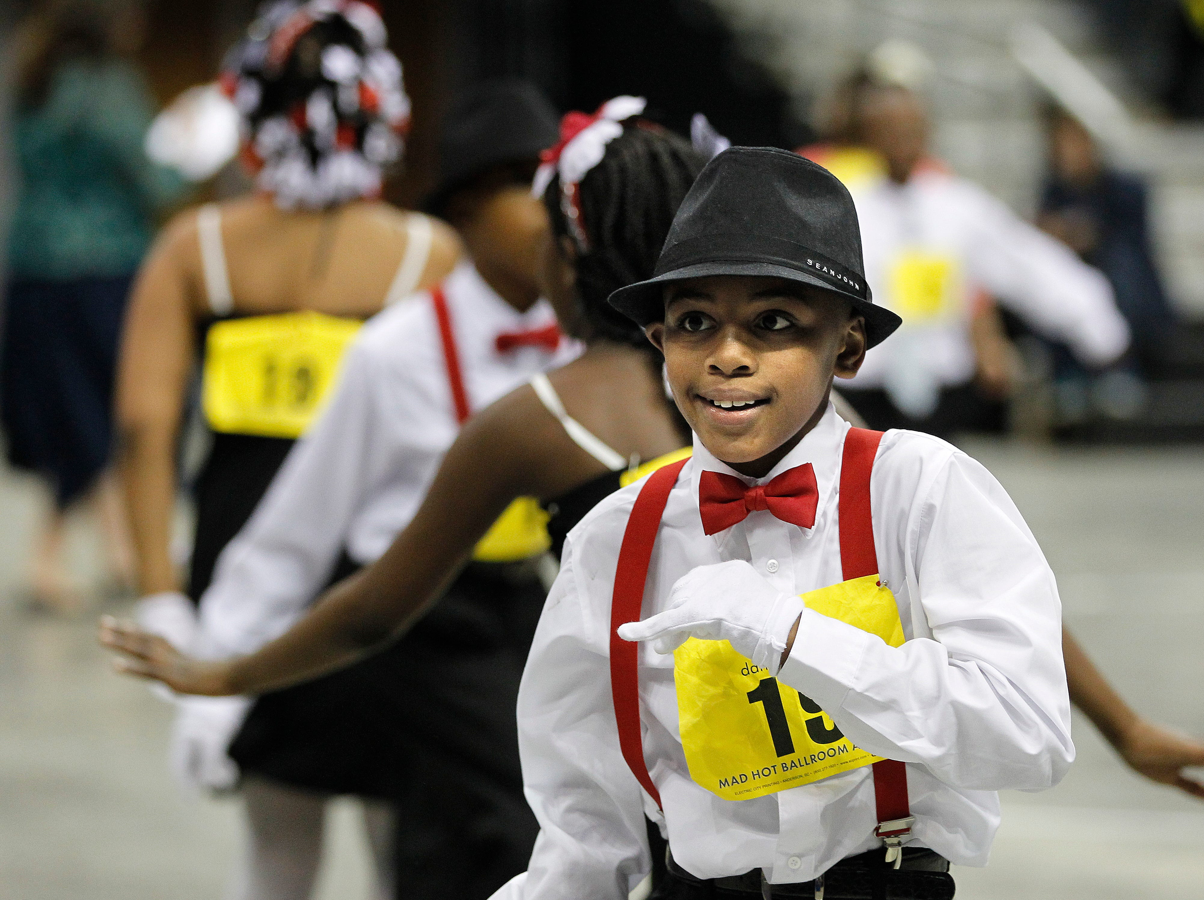 2014: Students from Hopkins Lloyd Community School dance during the annual Mad Hot Ballroom and Tap competition at the BMO Harris Bradley Center.