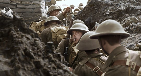 "British soldiers head out of the trenches in a scene from ""They Shall Not Grow Old."" Filmmaker Peter Jackson restored and added color to century-old footage from the First World War to bring to life the world of the average soldier during the ""war to end all wars."""