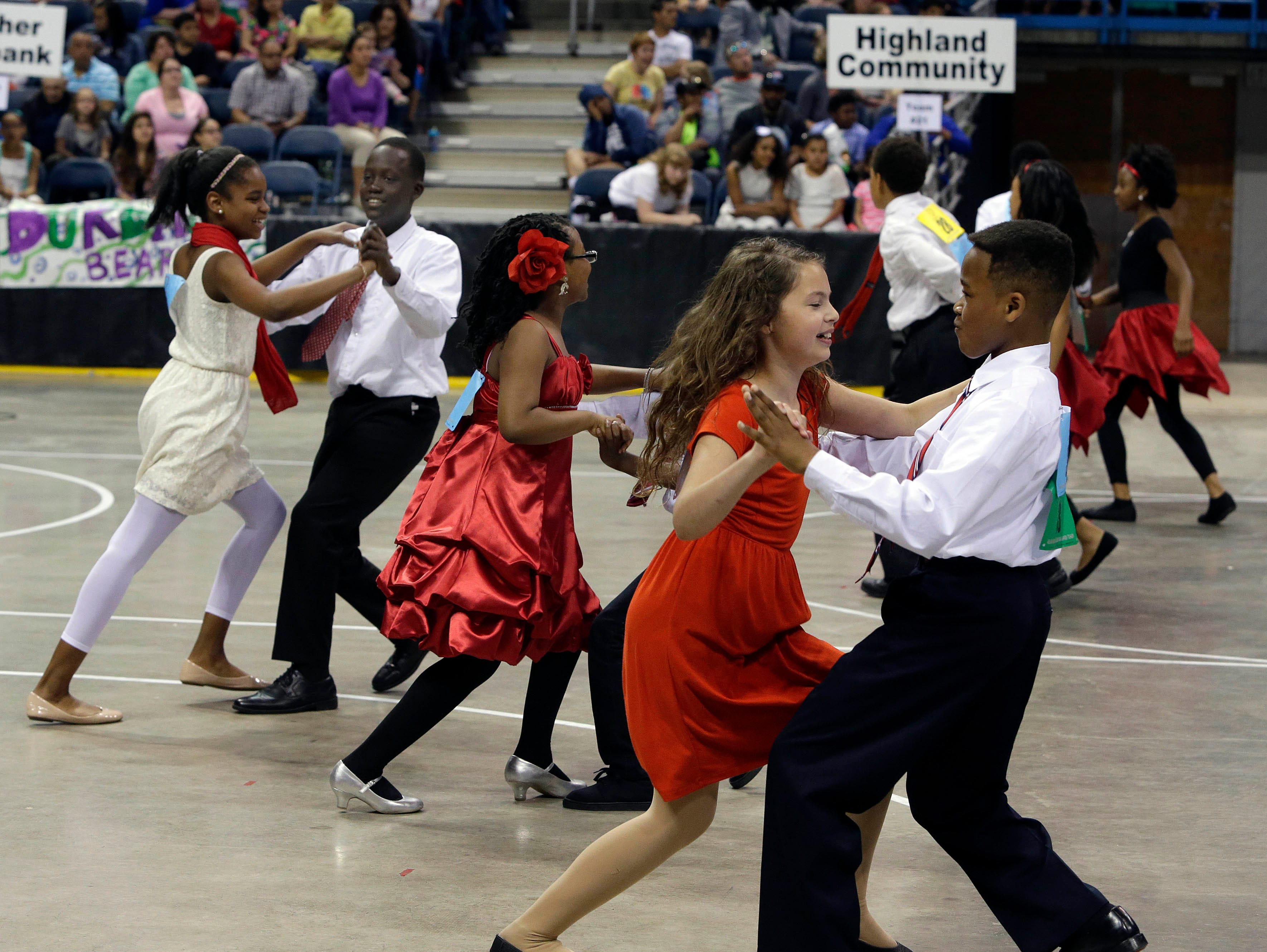 2015: From left couples Nigirea Brown and Khadim Dime; Kada King (bow) and Robert Ihoden; and Sophia Seymour and Cliffton Kincaid, all 5th graders at French Immersion School, perform and compete in the annual Mad Hot Ballroom and Tap competition at the Bradley Center.