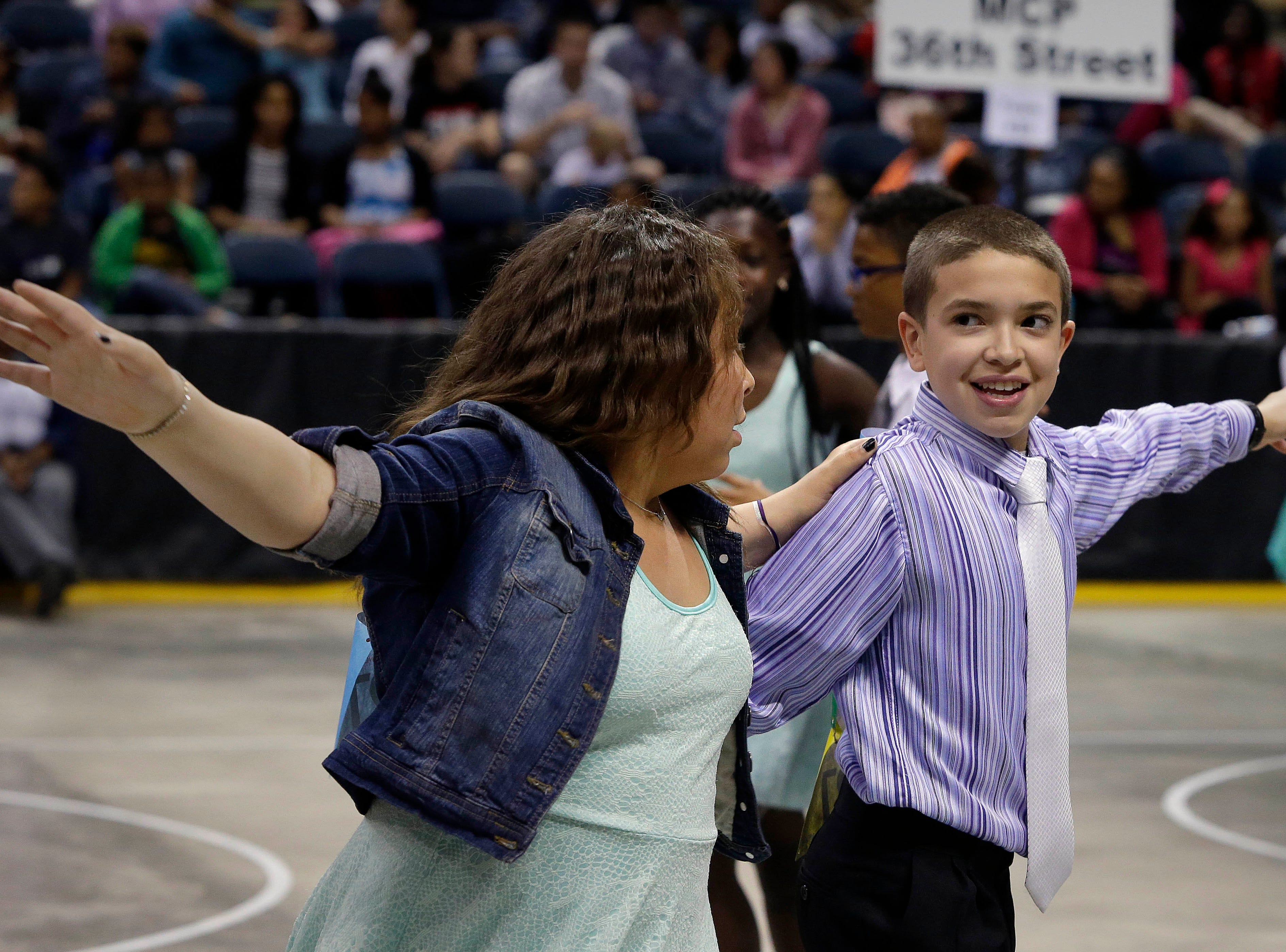 2015: Omariana  Randolph and Ian Sanchez, from Luther Burbank Elementary school,  compete in the tango during the annual Mad Hot Ballroom and Tap competition at the Bradley Center.
