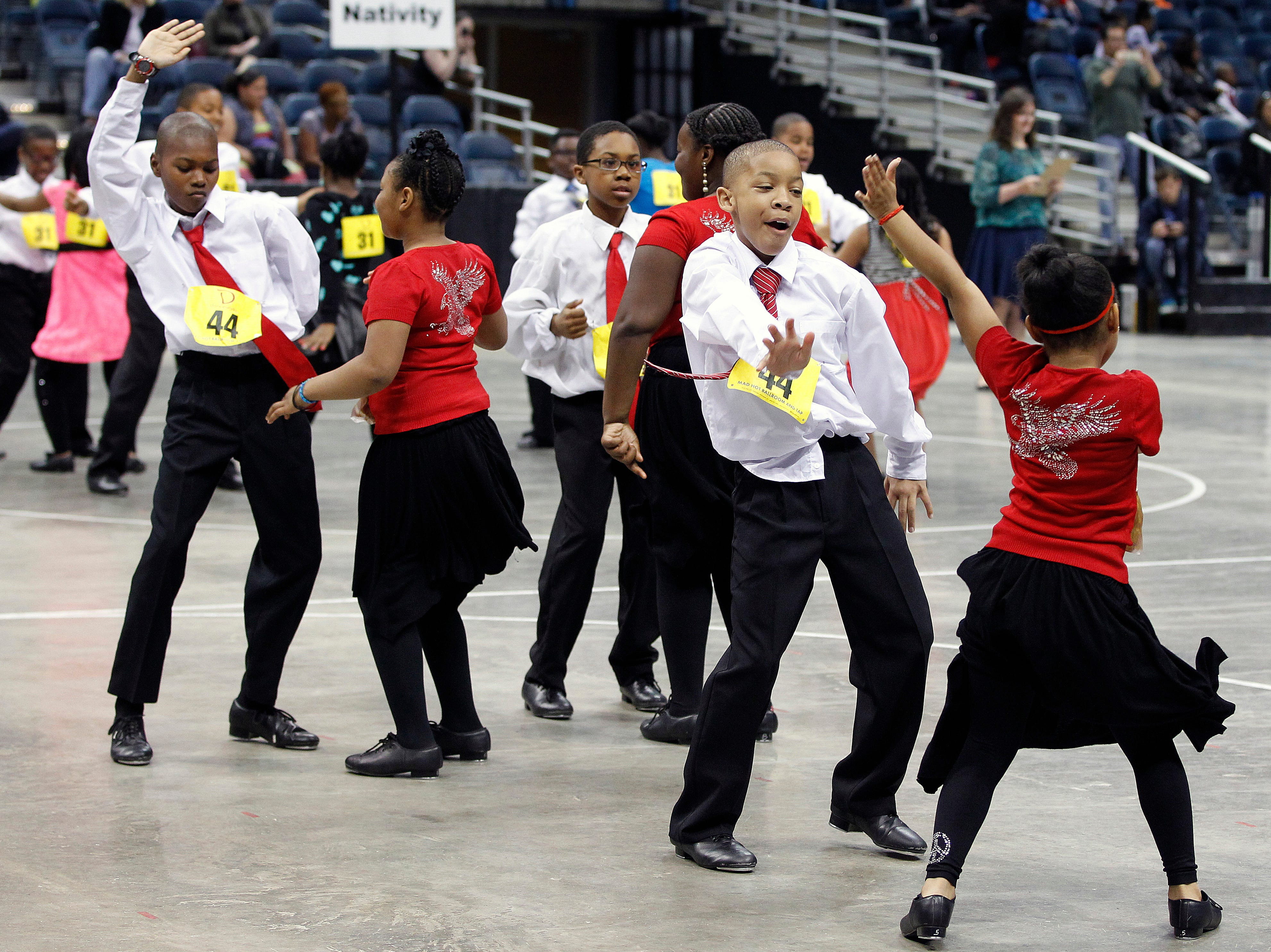 2014: Students from Siefert Elementary School dance during the annual Mad Hot Ballroom and Tap competition at the BMO Harris Bradley Center.