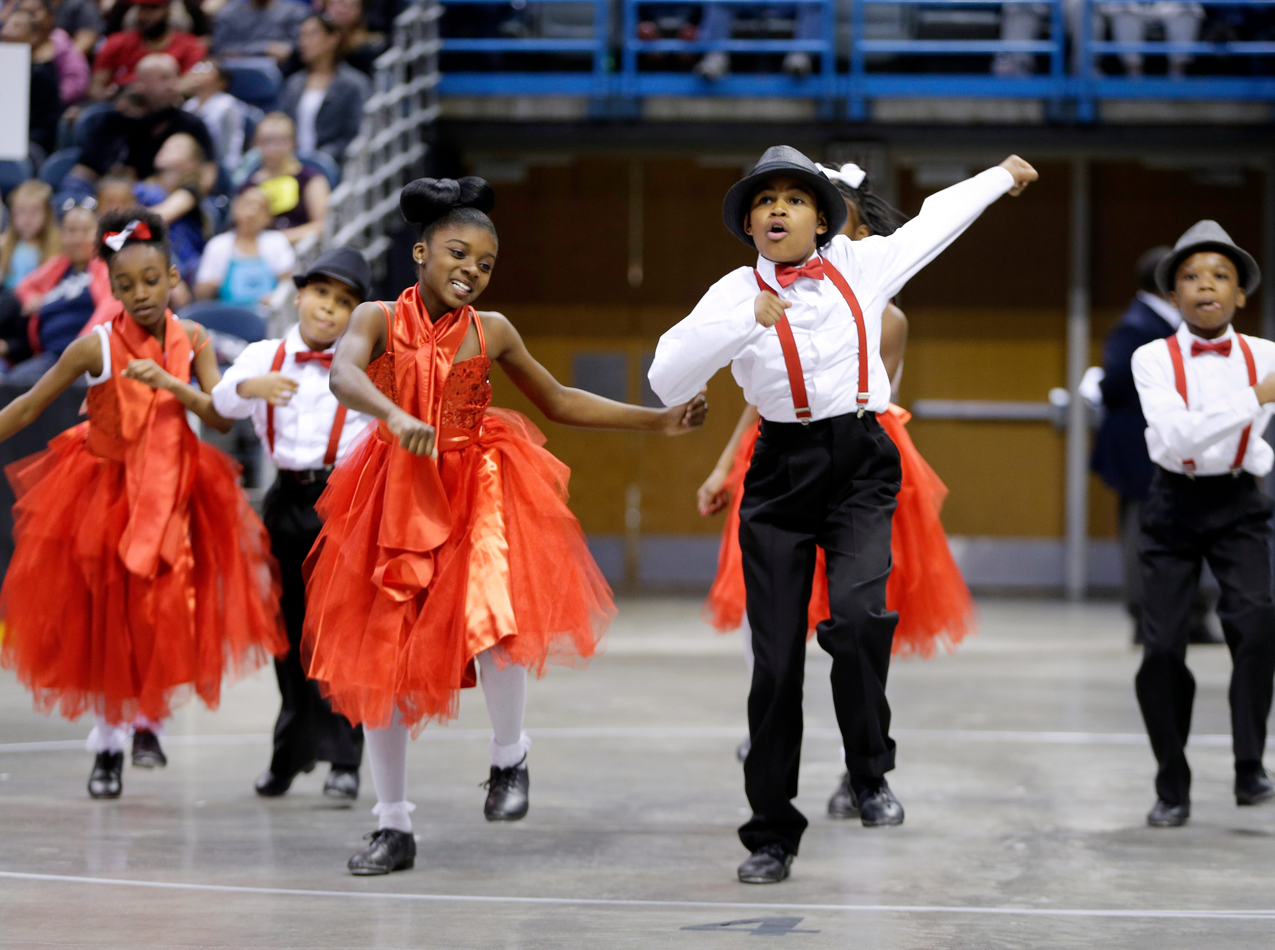 2016: Montana Love (left), Emeillio Daz (back left), Shawntyona Jones, Davell Costillio (center), Sarray Phillips and Eavonie Variott, (back right), all 10 year-old  students at Kilbourn Elementary School, perform swing dancing during the annual Mad Hot Ballroom and Tap competition at the BMO Harris Bradley Center.
