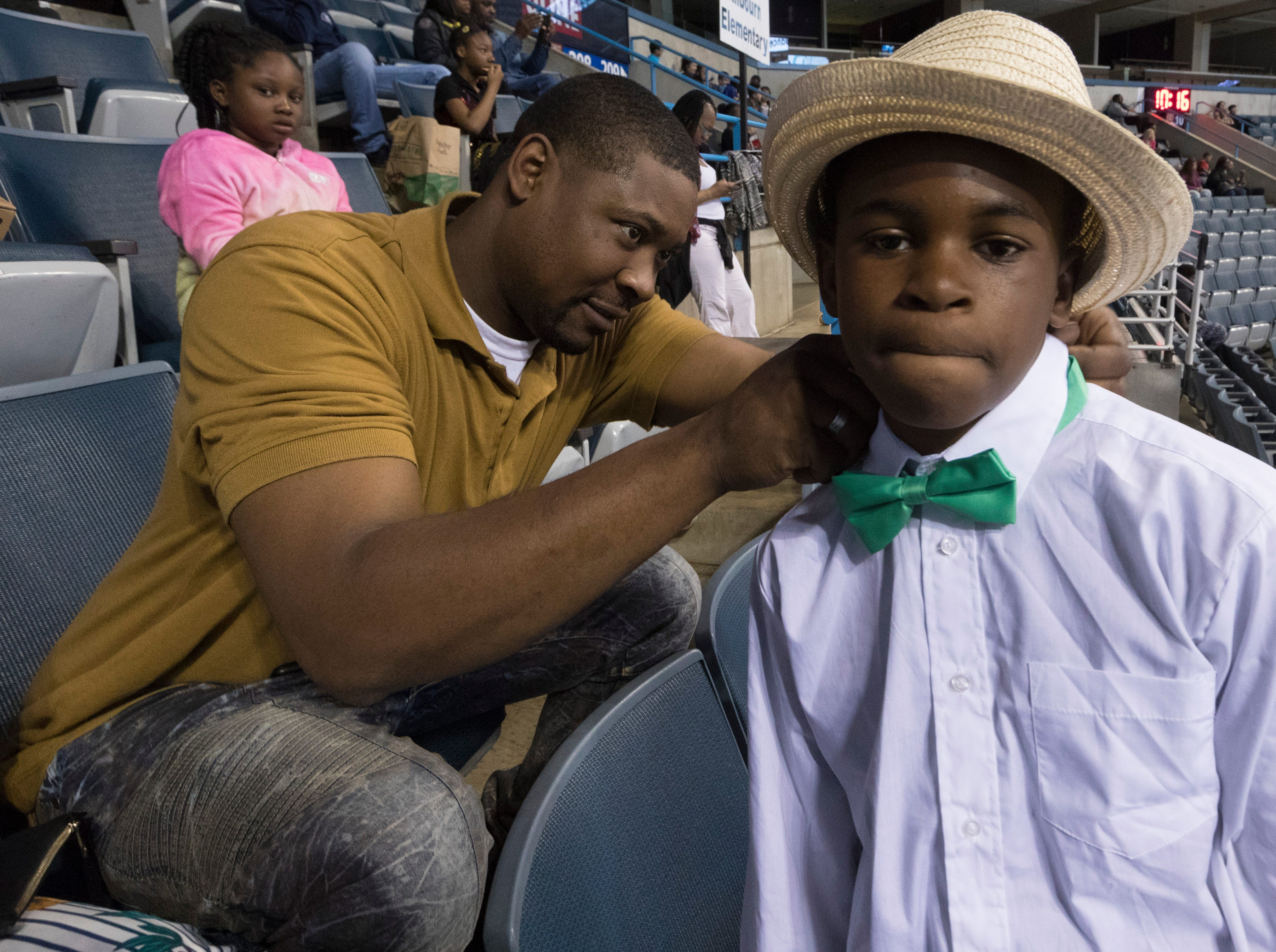 2018: Fifth grader Jason Duncan gets help with his tie from his father, Keenen, during the 12th annual Danceworks Mad Hot Ballroom and Tap Competition at the BMO Harris Bradley Center. Jason is a student at the Wisconsin Conservatory of Lifelong Learning.