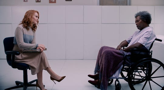 "Sarah Paulson (left) tries to get inside Samuel L. Jackson's head in ""Glass."" ("