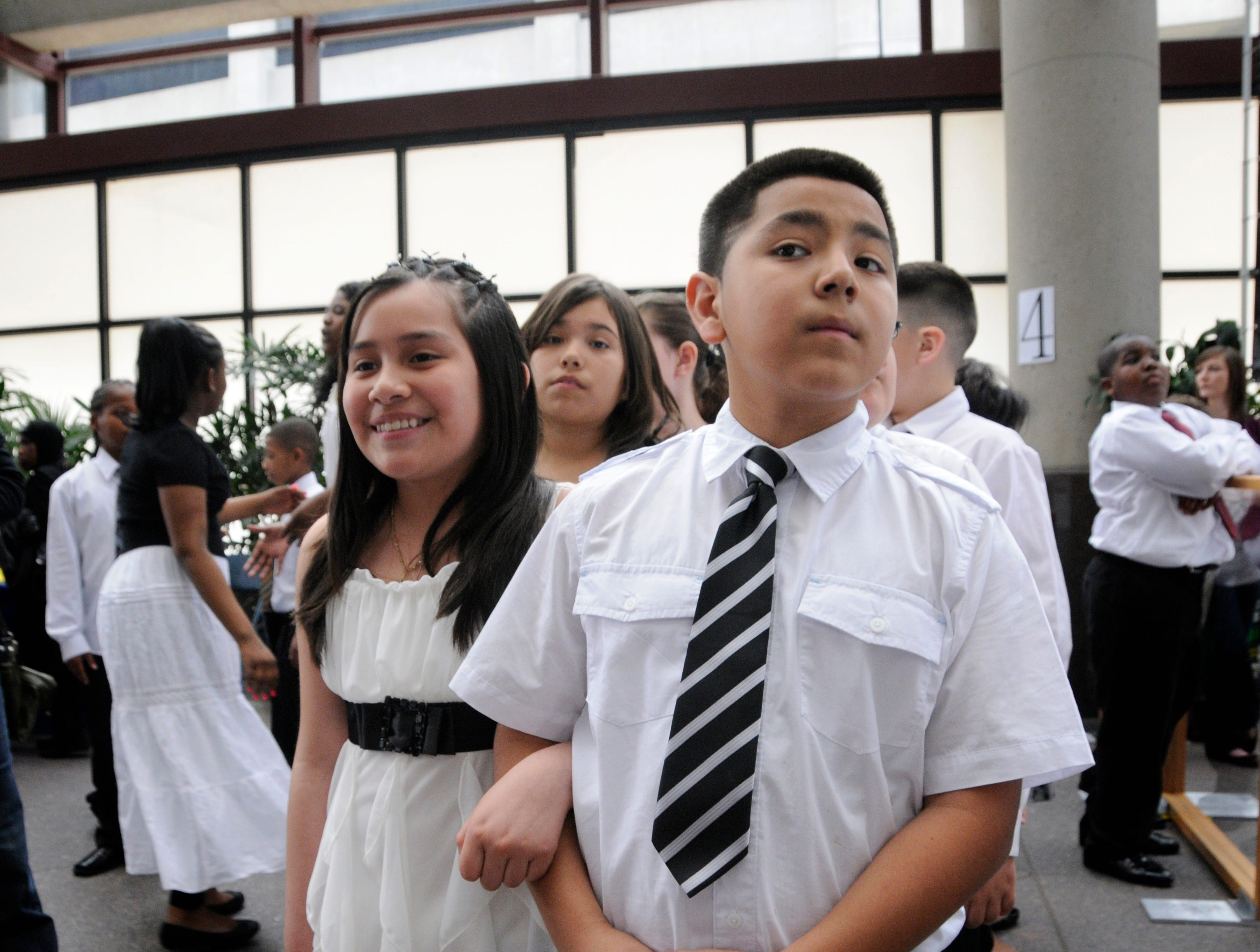 2012: Miriam Jargas and Miguel Quintana, both fifth graders from Doerfler School in Milwaukee, wait in line to go on the floor during the Danceworks Mad Hot Ballroom.