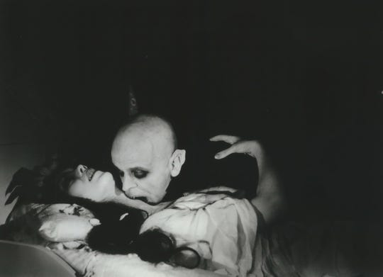 "The vampire (Klaus Kinski) lays claim to his victim (Isabelle Adjani) in Werner Herzog's 1979 Dracula adaptation ""Nosferatu."""
