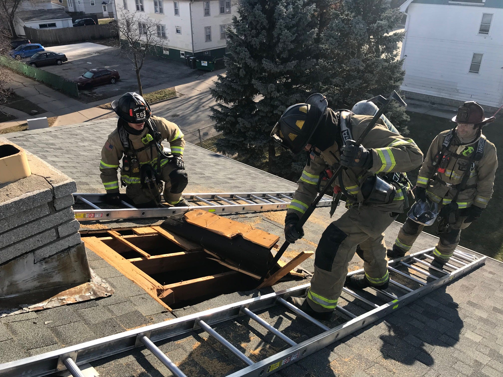 A rare chance to practice punching a gaping hole in a roof, a technique needed to fight many fires, is afforded West Allis firefighters by Chr. Hansen, which will raze the building.