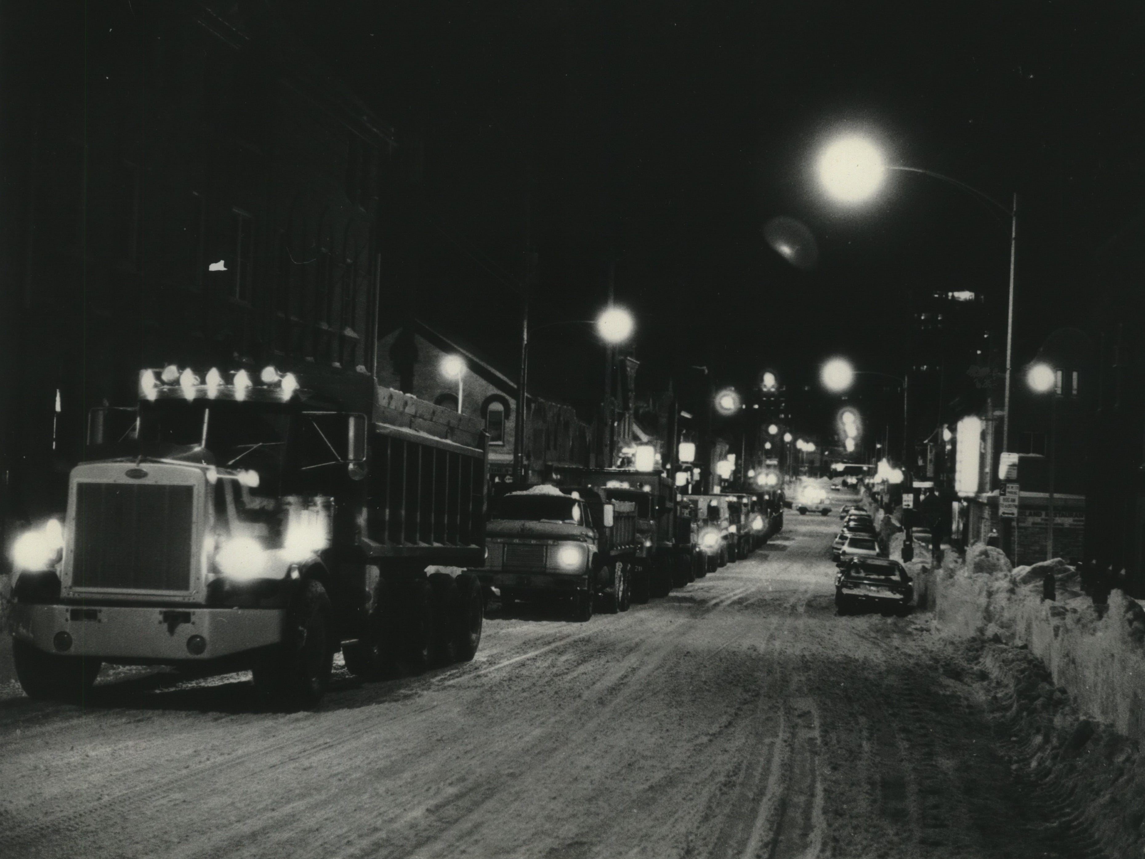 National Guardsmen and city workers invade Brady Street on the city's east side on Jan. 19, 1979, to accelerate cleanup after Milwaukee was hit by its second major snowstorm in two weeks. This photo was published in the Jan. 20, 1979, Milwaukee Sentinel.
