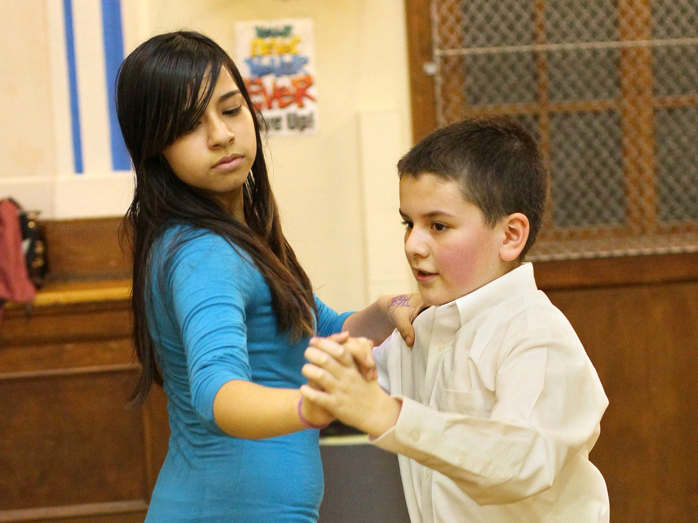 2011: Luis Mora dances with classmate Tanith Husein at Vieau School in Milwaukee. They are preparing for the Mad Hot Ballroom at the Bradley Center.