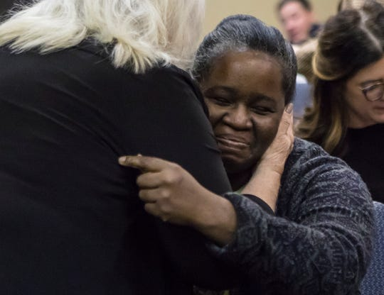 "Shalandra White receives a hug after she spoke about her personal financial hardship during 2018 A.L.I.C.E. report at the United Way of Northeast Louisiana's office in Monroe, La. on Jan 15. The report details the financial instability of working families in La. and when White was evicted from her home, with her two children, due to her rent being raised despite wage increases at her job she became the exact person the report details. ""It's better to get a real story instead of looking at numbers on a page,"" White said."