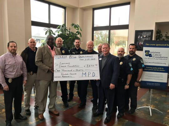 MPD presents $1,030 check to Louisiana Cancer Foundation.