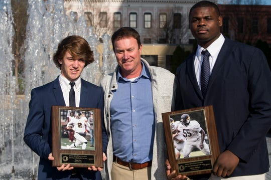 Autauga Academy's Tripp Carr, coach Bobby Carr and Adarius Tolliver during the Mr. Football awards banquet in Montgomery, Ala., on Tuesday, Jan. 15, 2019.