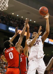Auburn center Austin Wiley (50) takes a shot over Georgia Bulldogs forward Nicolas Claxton (33) and guard William Jackson (0) on Jan. 12, 2019.