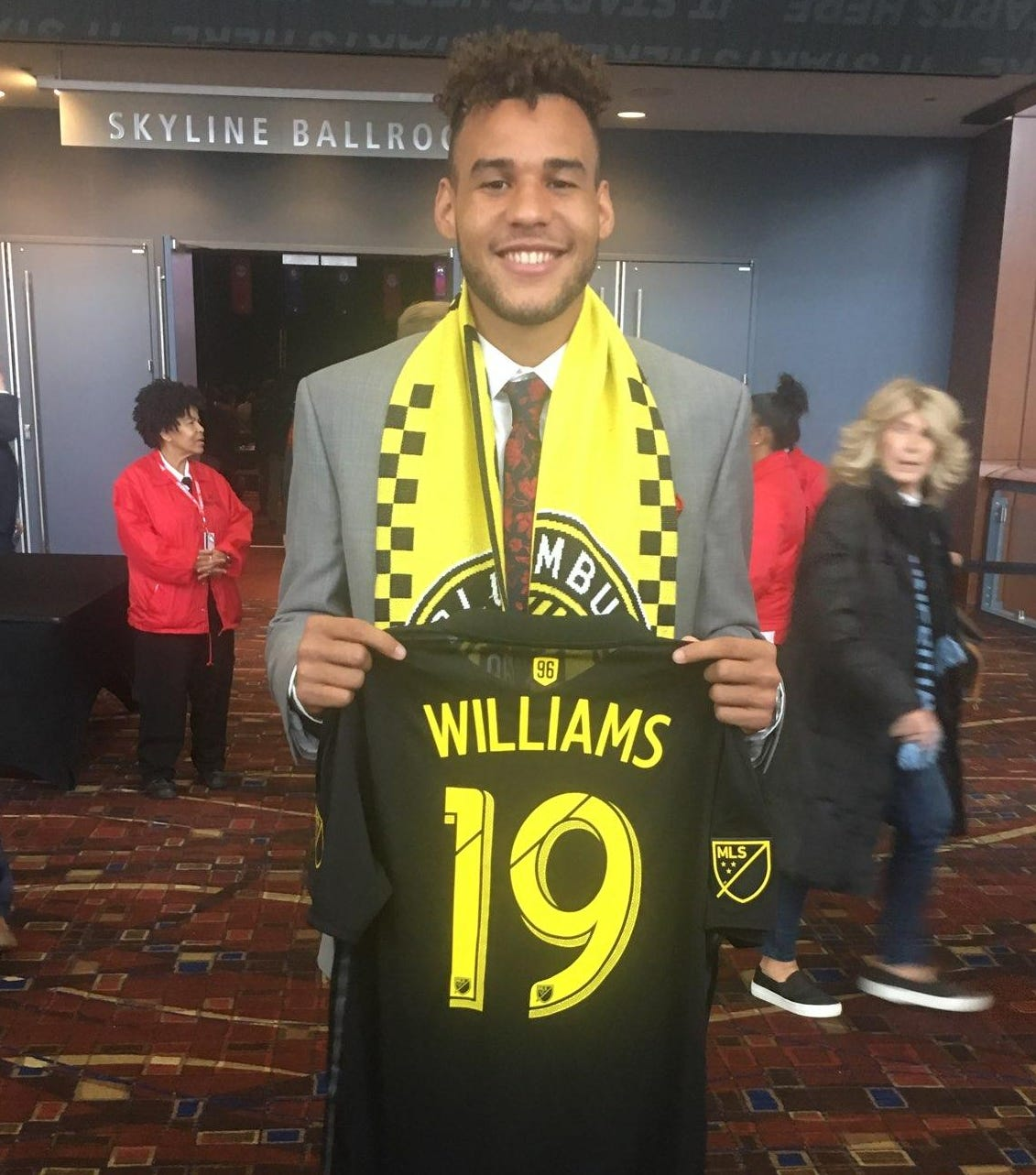 J.J. Williams shows off his new Columbus Crew gear after being taken with the 18th overall pick in last weekend's Major League Soccer draft.