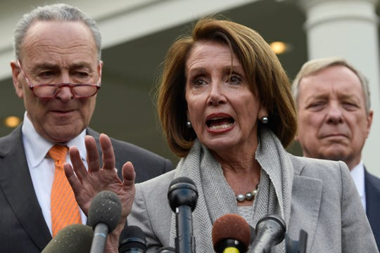 House Speaker Nancy Pelosi of Calif., center, speaks as she stands next to Senate Minority Leader Sen. Chuck Schumer of N.Y., left, and Sen. Dick Durbin, D-Ill., right, following their meeting with President Donald Trump at the White House in Washington, Wednesday, Jan. 9, 2019. (AP Photo/Susan Walsh)
