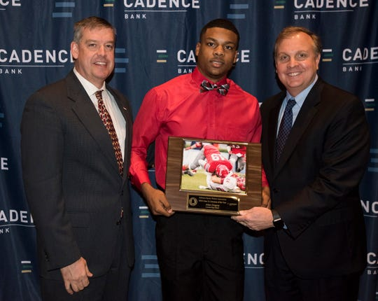 Luverne's Arian Gregory is awarded the Class 2A lineman of the year by AHSADCA Director Jamie Lee, left, and Cadence Bank Senior Vice President Bill Bennett, right, during the Mr. Football awards banquet in Montgomery, Ala., on Tuesday, Jan. 15, 2019.
