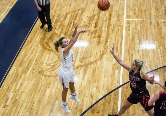 Delta's Brooklyn Matheny takes a shot during the championship game of the Delaware County Basketball Tournament. Delta won the title with a final score of 42-32.