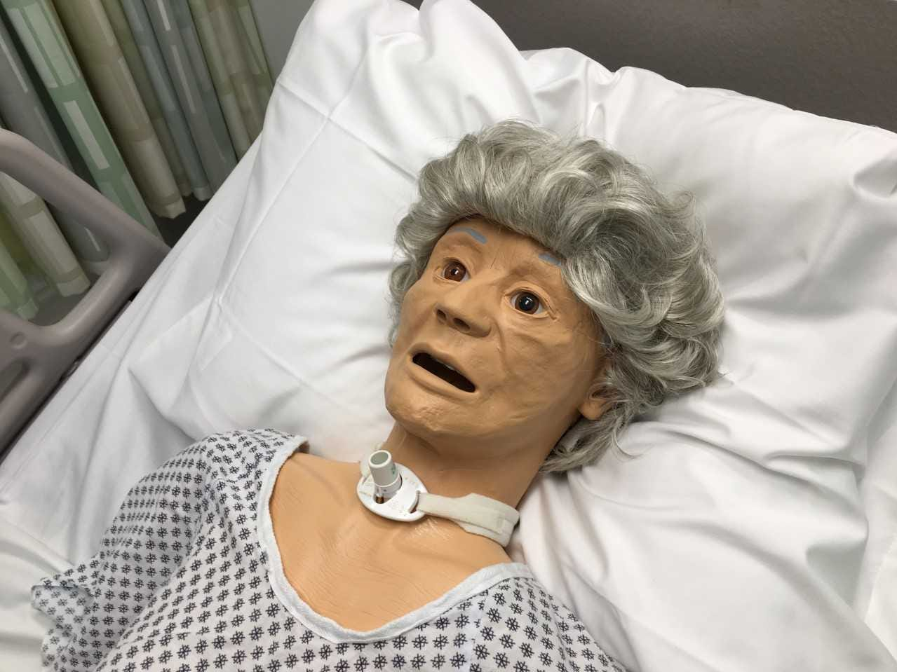 A patient simulator lies in a bed at Ivy Tech Community College in Muncie.