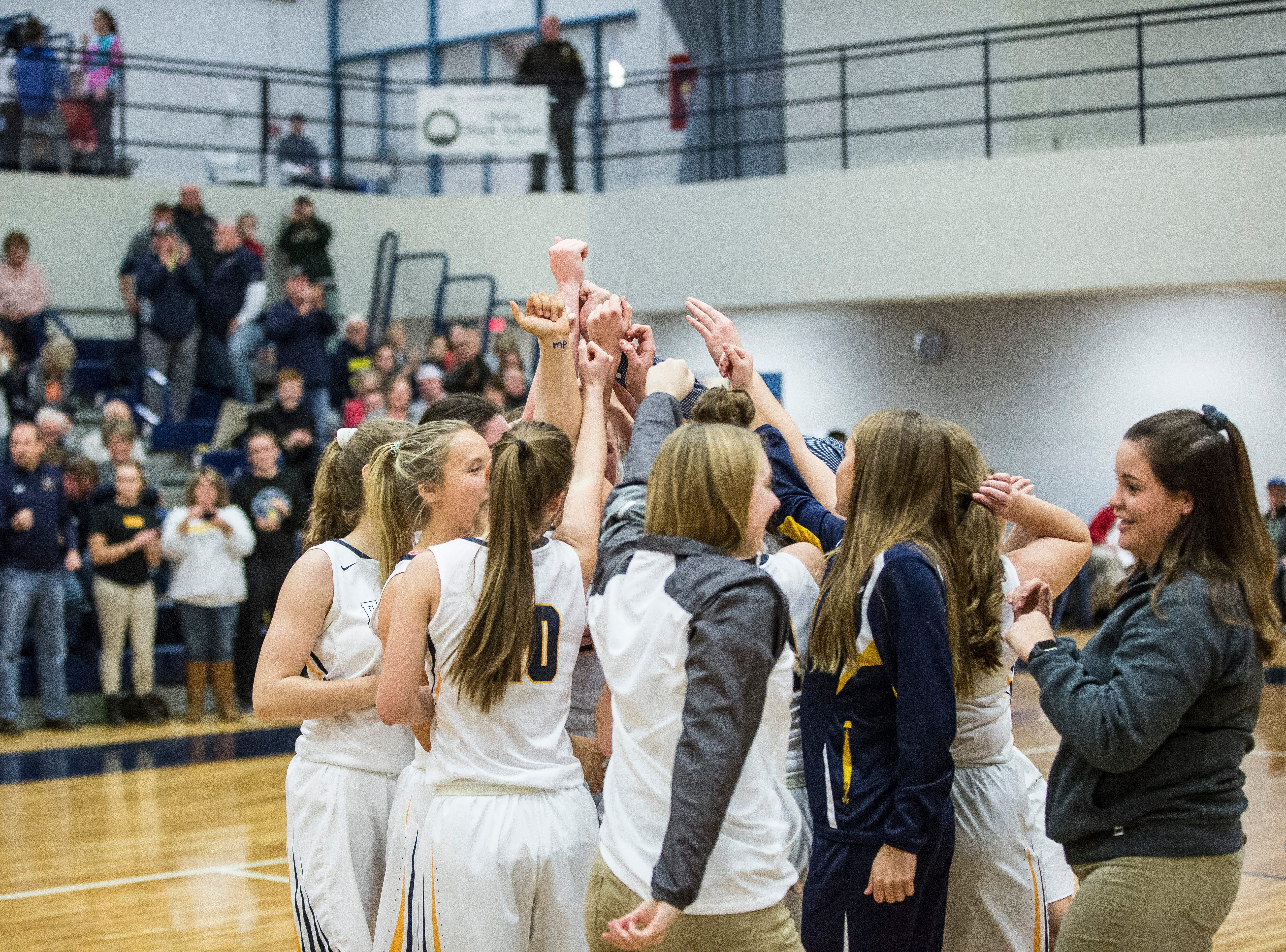 Delta celebrates their tile win against Wapahani Monday evening for the Delaware County Basketball Tournament championship game at Delta High School. Delta won the game 42-32.