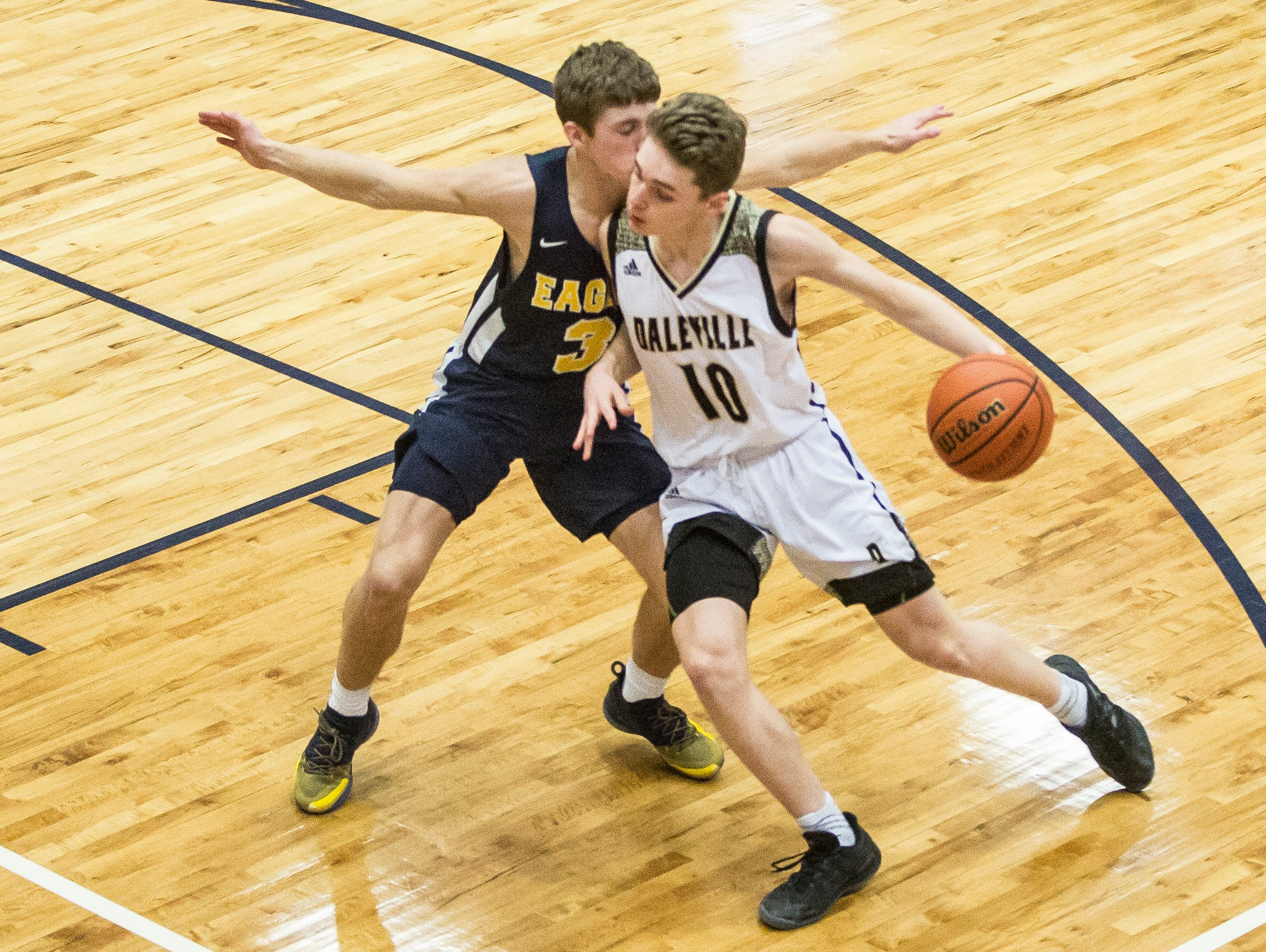 Daleville's Josh Price drives towards the net during the Delaware County Basketball Tournament championship game Monday night at Delta High School against Delta. Delta won the game 85-48.