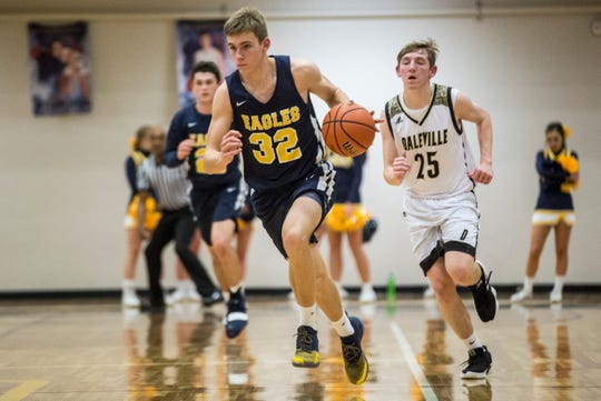 FILE -- Delta's Brady Hunt drives down the court during the Delaware County Basketball Tournament at Delta High School. Hunt returns as the Eagles leading scorer from a season ago.