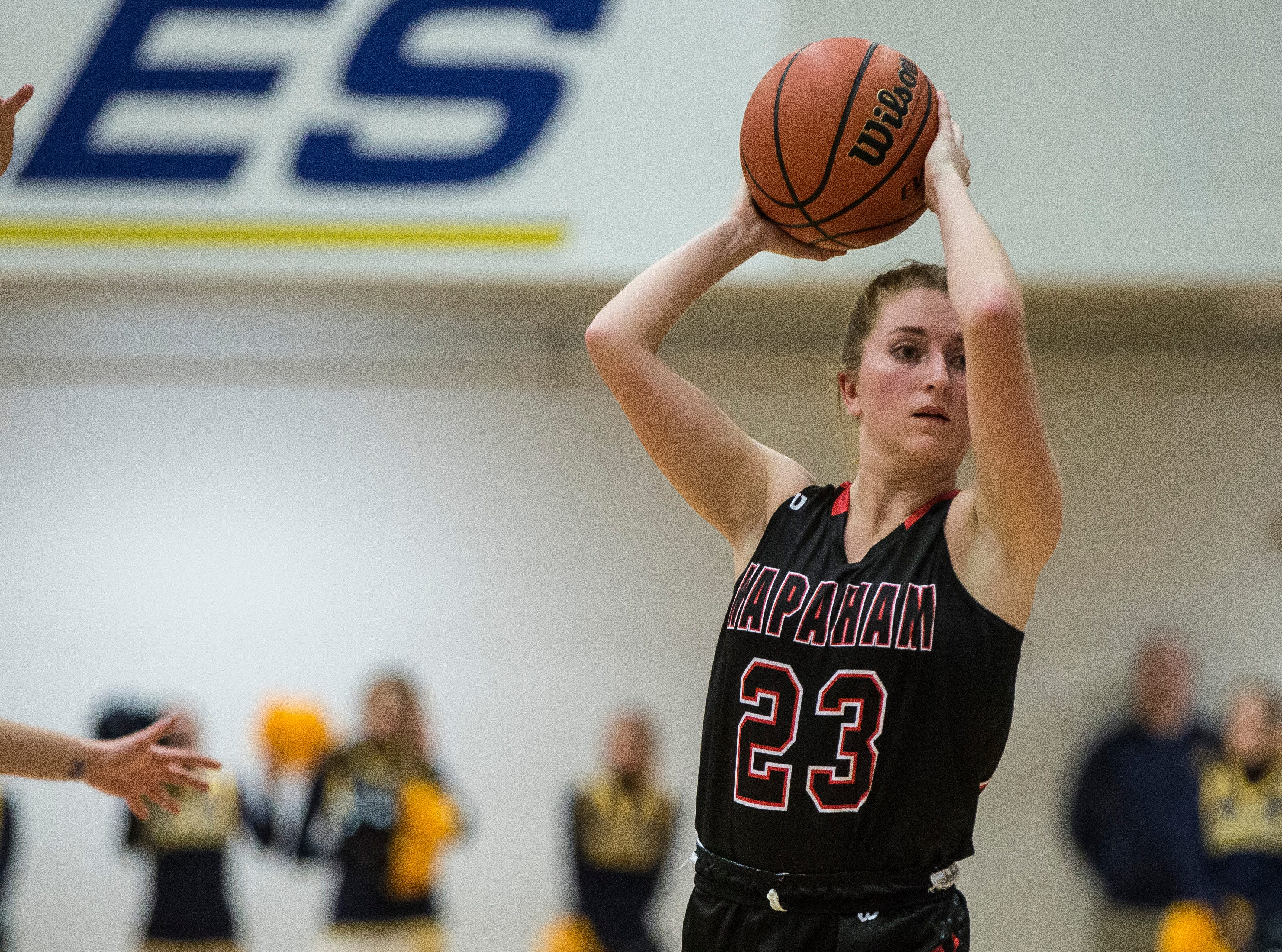 Wapahani's Carlie Boggs looks for an opening to pass during the Delaware County Basketball Tournament Championship Monday evening against Delta. Delta won the title with a final score of 42-32.