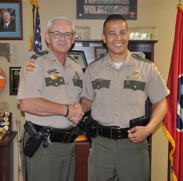 Former THP Col. Tracy Trott poses with Trooper Willie McCoy when he was promoted to sergeant. McCoy has since been demoted.