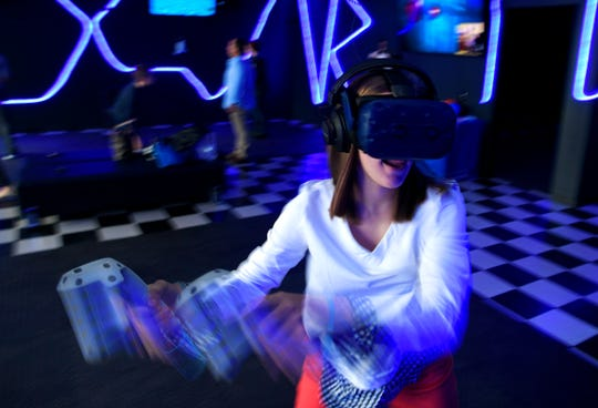 Skylar Webb plays a virtual reality game during her brother's birthday party at Digital Worlds Virtual Reality Arcade in Franklin on Saturday, Jan. 15, 2019.