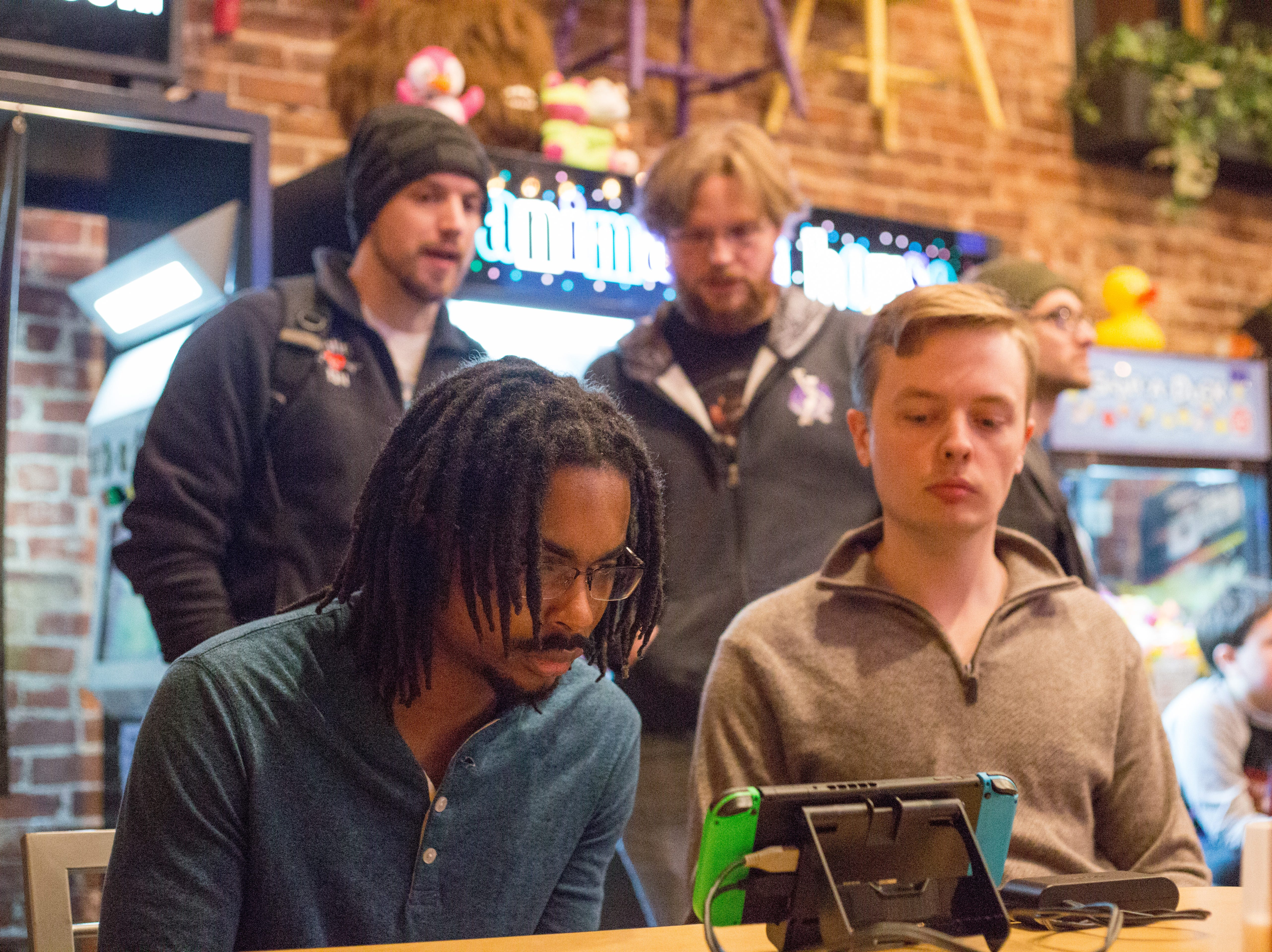 Andrew Reid (left) plays at his table during a Super Smash Brothers Ultimate Tournament presented by Big Dad Games at Filly's Game and Grill in Gallatin on Monday, Jan 14.