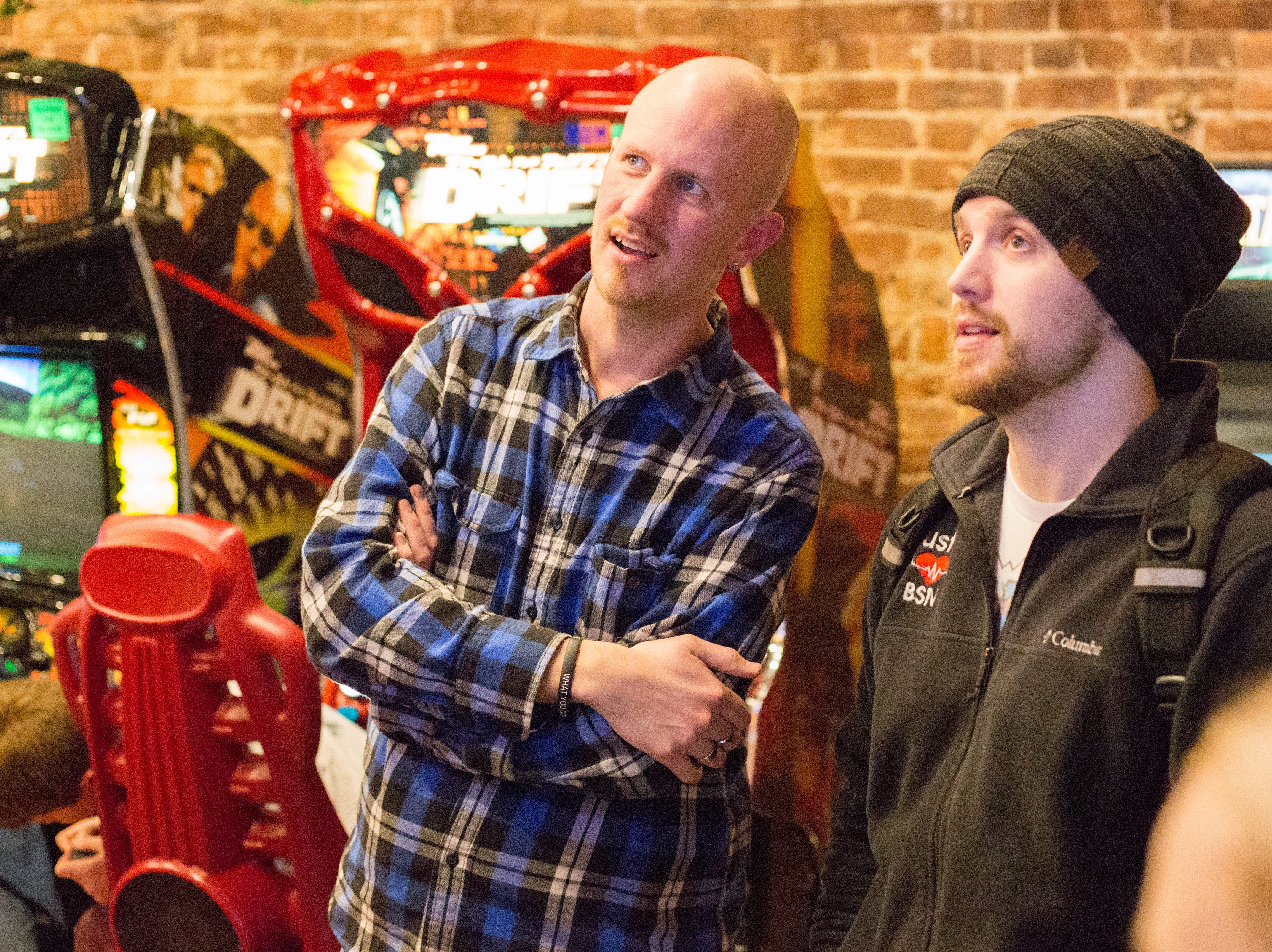 Jason Tomlinson (left), founder of Big Dad Games, chats with attendees during a Super Smash Brothers Ultimate Tournament presented by Big Dad Games at Filly's Game and Grill in Gallatin on Monday, Jan 14.