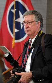 Jed DeKalb, a soon-to-be retired state photographer who has worked under five governors.