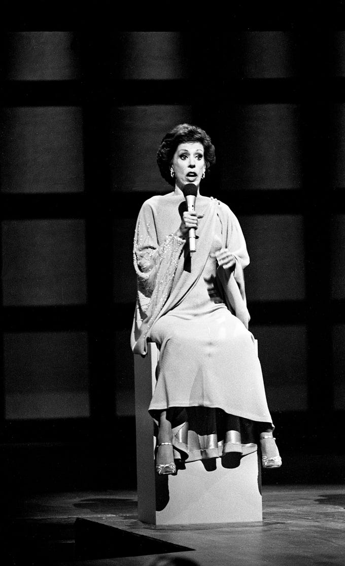 """Carol Burnett gets things started for the """"Pedestal Song"""" during the taping of the """"Dolly and Carol in Nashville"""" television special before a packed audience at the Grand Ole Opry House Jan. 10, 1979. The special airs on CBS Feb. 14."""
