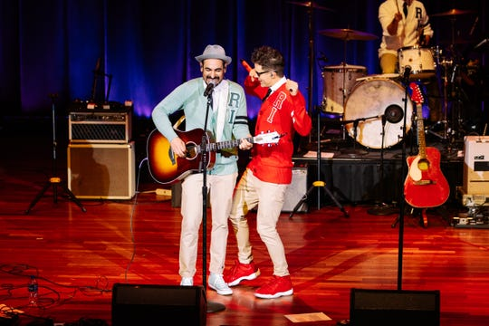 Producer Eddie and Bobby Bones perform as The Raging Idiots at their Million Dollar show at Ryman Auditorium.