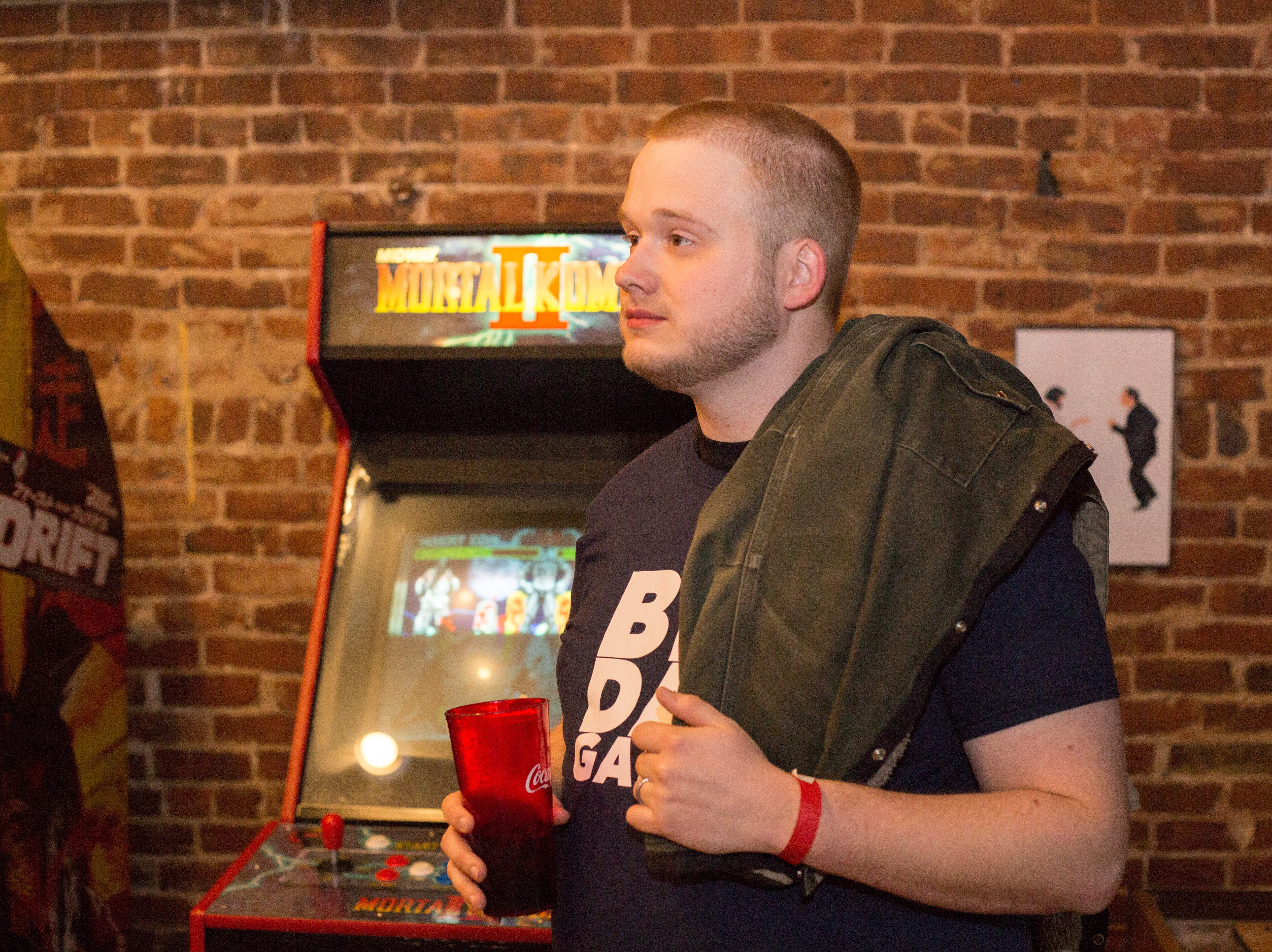 Thomas Dean watches the action during a Super Smash Brothers Ultimate Tournament presented by Big Dad Games at Filly's Game and Grill in Gallatin on Monday, Jan 14.