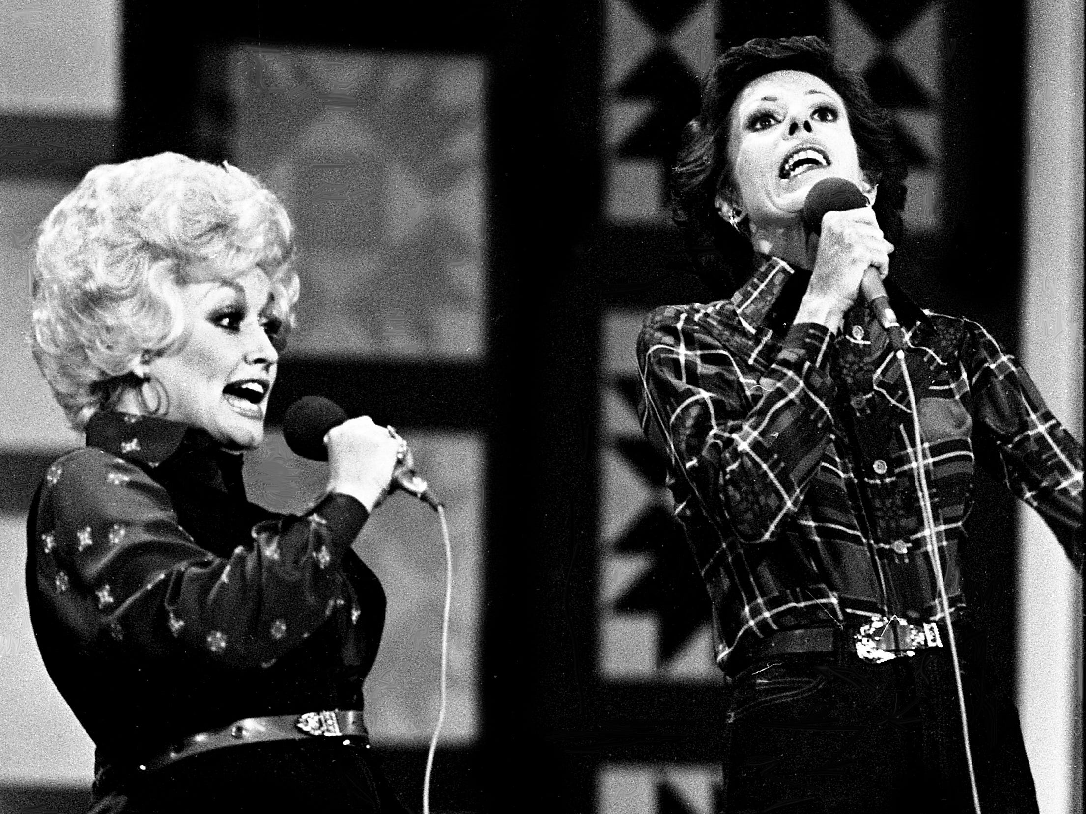 """After Carol Burnett, right, tells Dolly Parton that """"No one picks like a Nashville picker,"""" it turned into a hilarious musical number skit during the taping of the """"Dolly and Carol in Nashville"""" television special before a packed audience at the Grand Ole Opry House Jan. 10, 1979."""